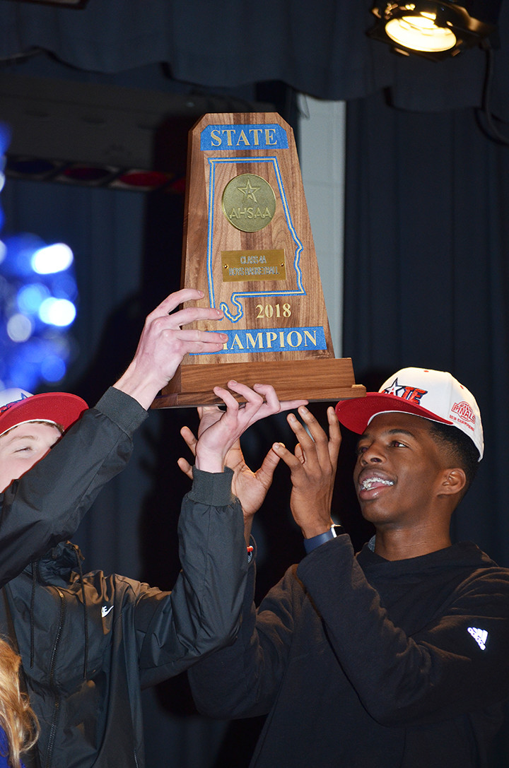 Cordova High School's Jayce Willingham, left, and Isaac Chatman, right, hold up the state championship trophy during an assembly recognizing the team at the school on Monday. The Blue Devils won the Class 4A championship game Friday night, beating Madison Academy 56-54 at the Legacy Arena at the Birmingham-Jefferson Civic Center in Birmingham.