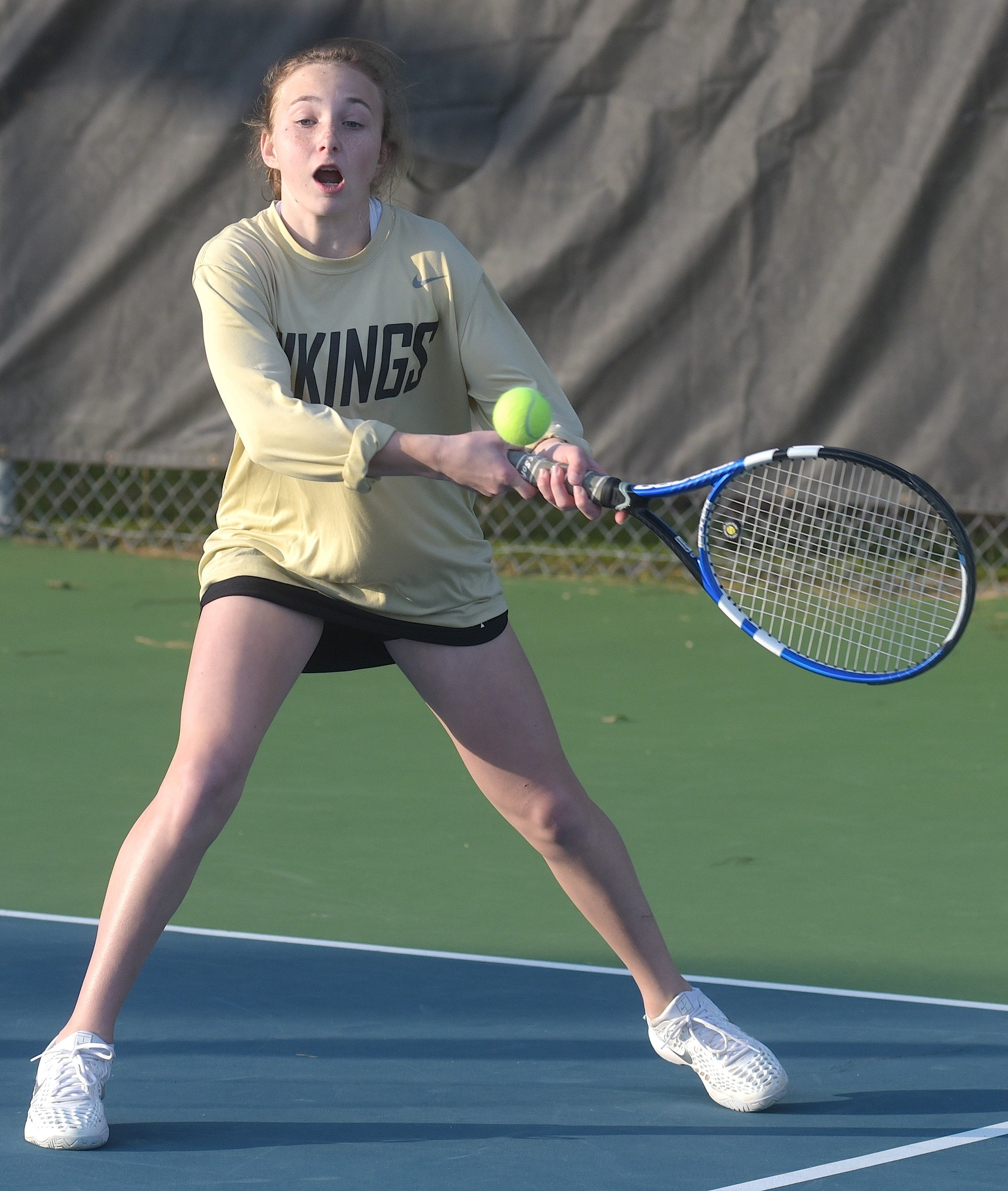 Jasper's Sophia Poolos hits a backhand during her No. 1 doubles match on Wednesday.