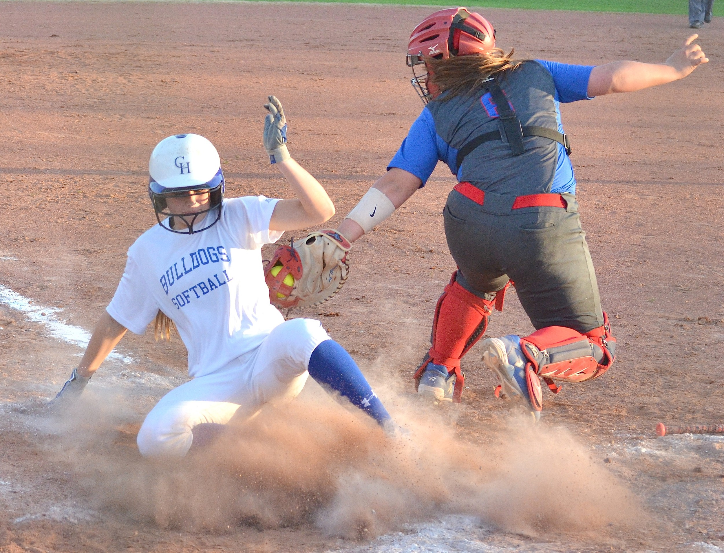 Carbon Hill's Katie Moore, left, beats the tag of Cordova's Ansley Ardoin during their Class 4A, Area 9 game at Cordova High School on Tuesday. The Bulldogs scored four runs in the sixth inning to earn a 6-3 win over Cordova.