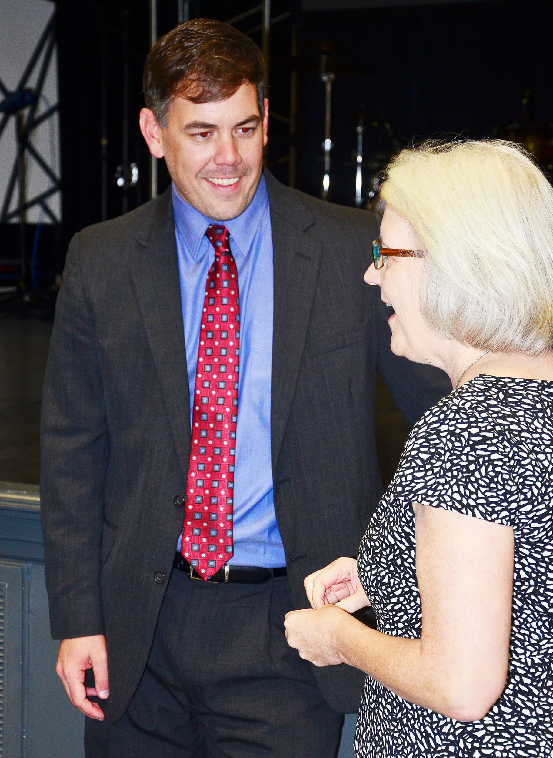 Andy Byars, a co-chair for the 2016 United Way campaign in Walker County, speaks with Connie Hill, CEO of Girls Inc., after the United Way kickoff meeting Thursday at the Jasper Civic Center.  Daily Mountain Eagle - James Phillips