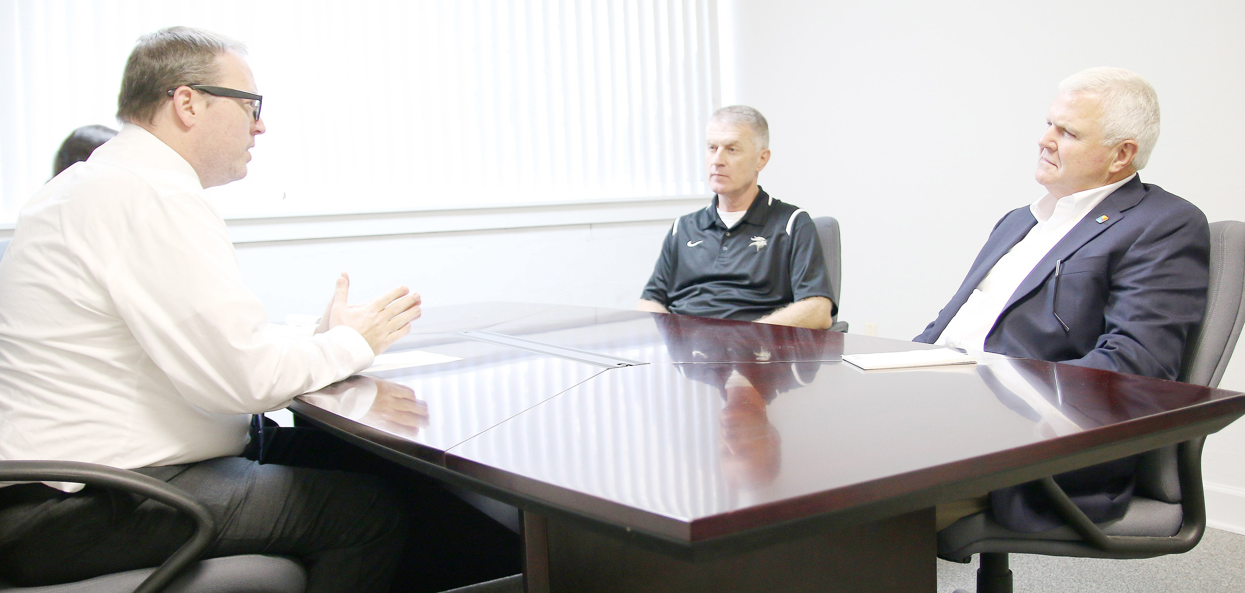 Daily Mountain Eagle publisher James Phillips, at left, sat down with Jasper mayoral candidates Greg Tinker and David O'Mary Friday for a 90-minute discussion on their plans if elected mayor. Tinker and O'Mary will face off in Tuesday's runoff election. Daily Mountain Eagle - Malarie Brakefield