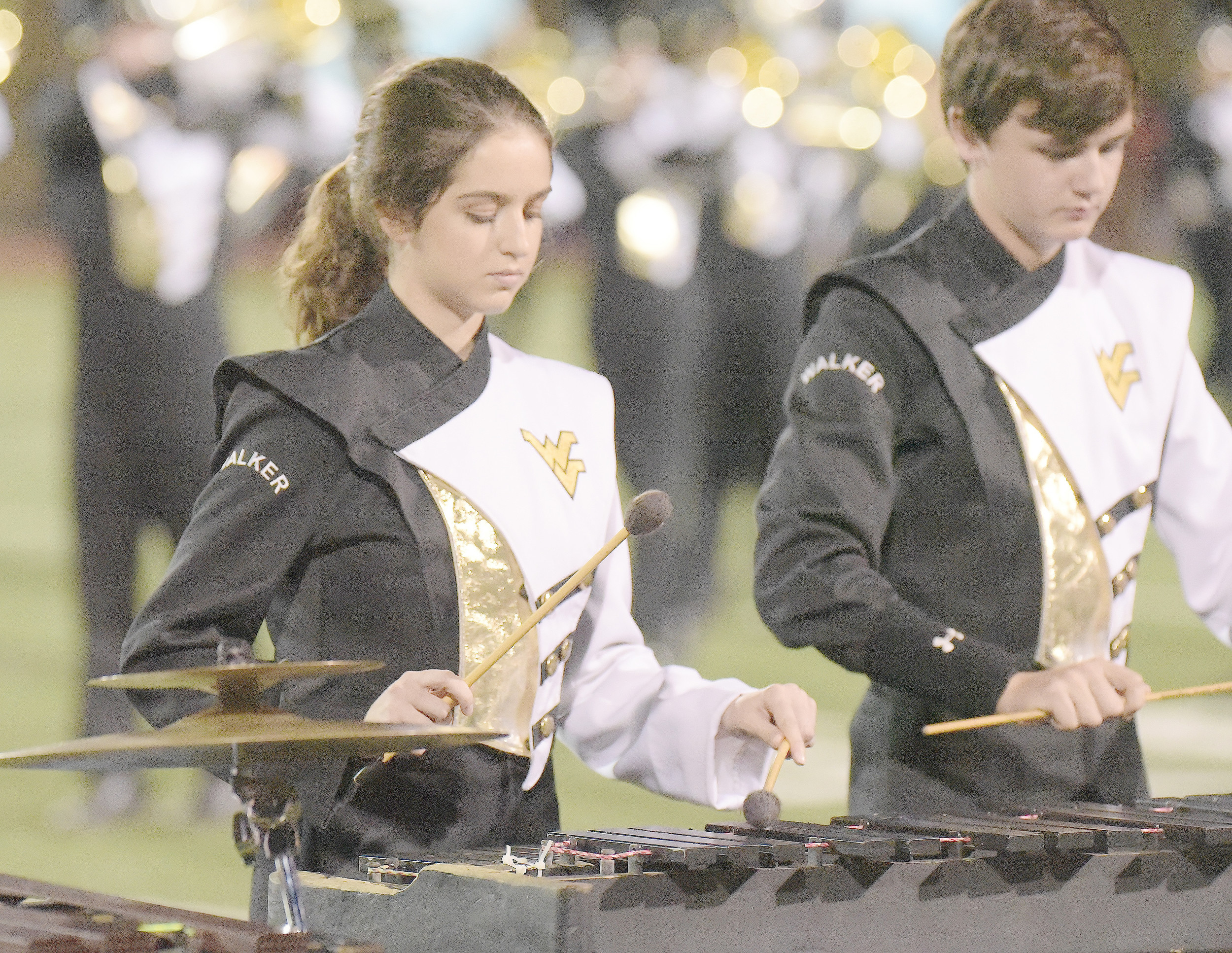 "Chiara Scirocco, at left, said she loves being a part of Walker High School's band. ""I enjoy every single moment with them. I laugh, I sing, I dance all the time and play, and it's very, very fun. ... I really love it,"" she said. Daily Mountain Eagle - Ron Harris"