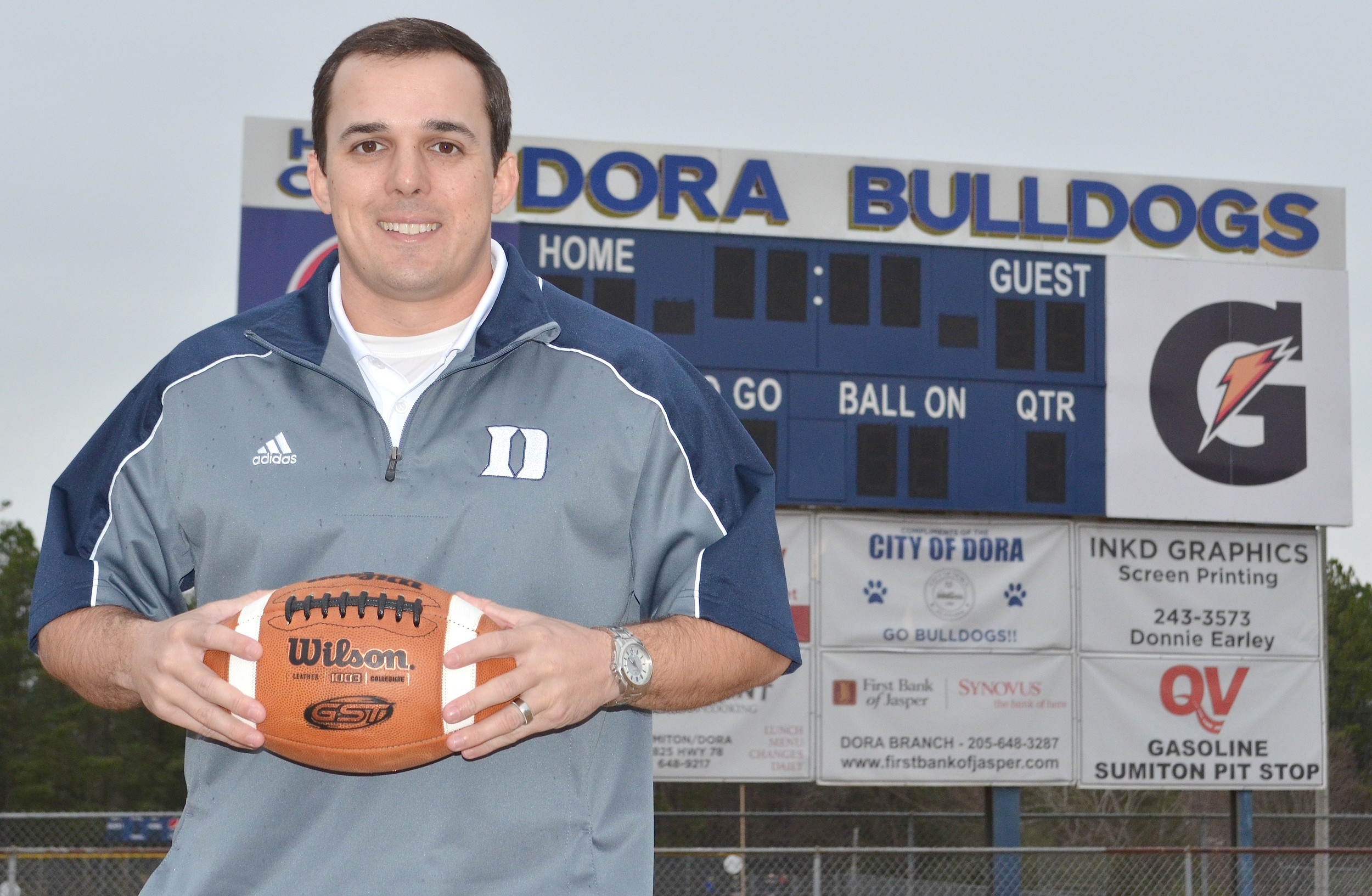 New Dora football coach Bart Lockhart looks to rebuild the Bulldogs' legacy after four straight losing seasons.