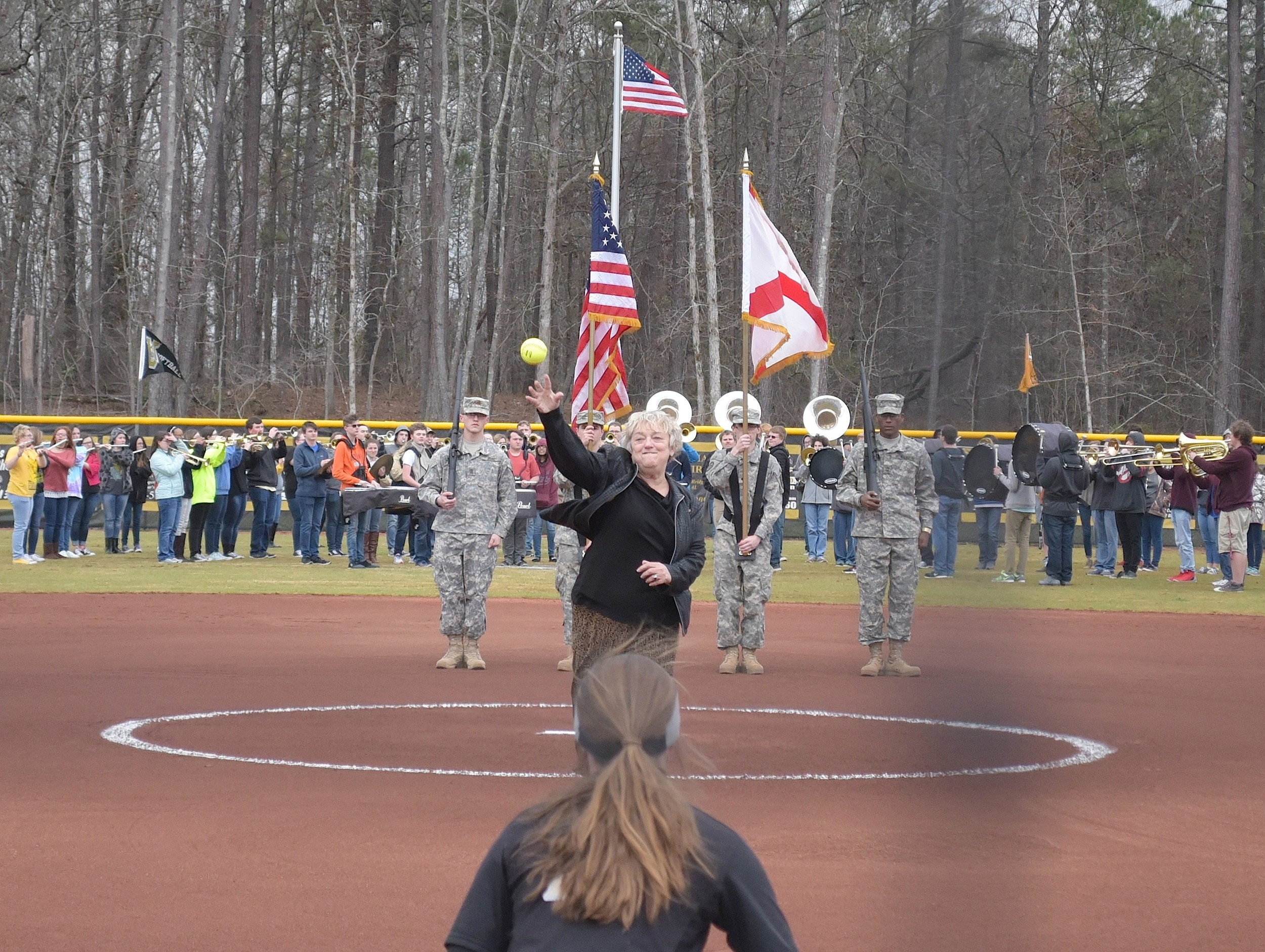 Wanda Gilliland of the Alabama High School Athletic Association throws out the first pitch prior to Walker's first game on its new field Tuesday.