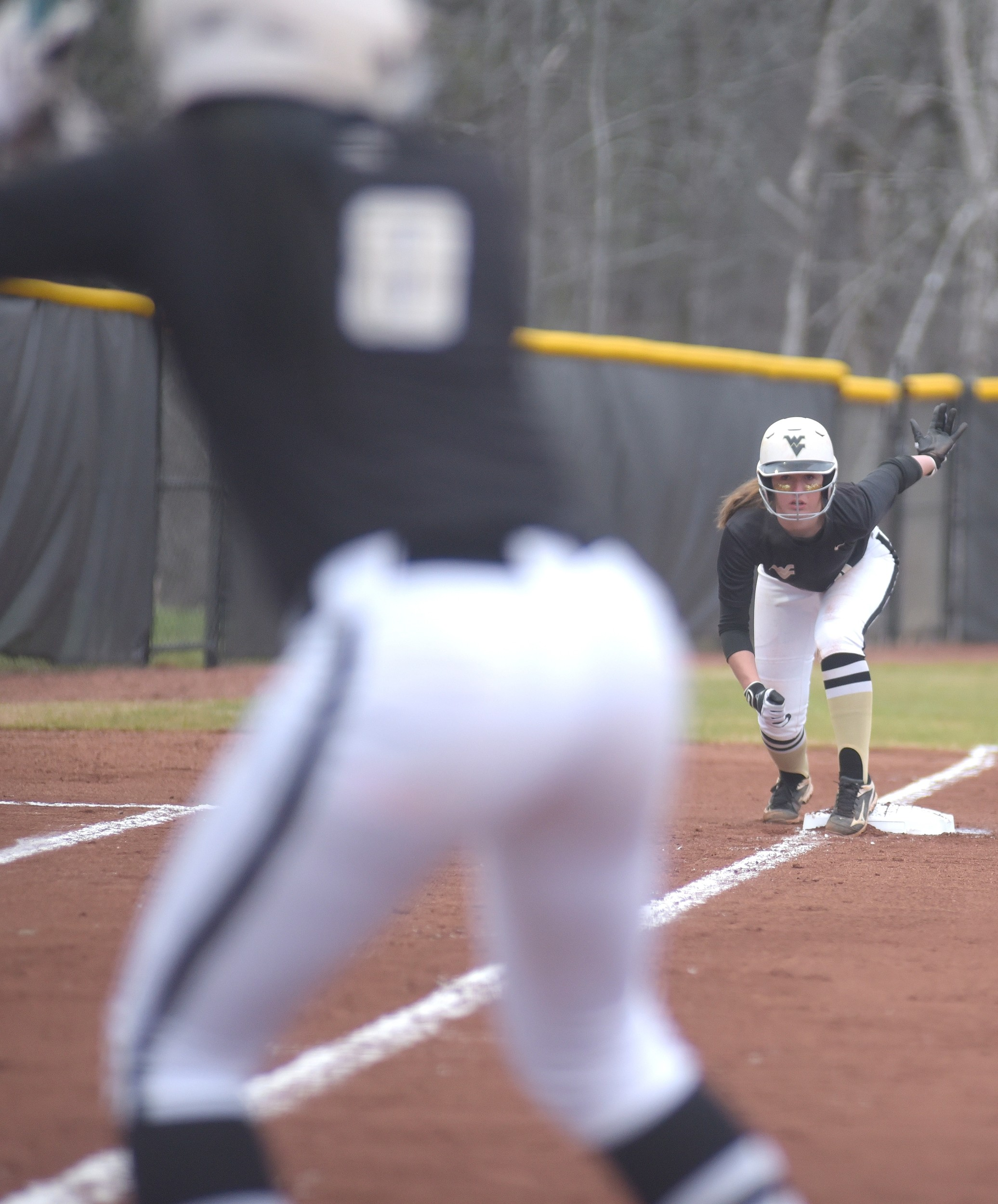 Walker's Ansley Lay takes a lead off third base during Tuesday's home opener against Gardendale. Walker lost 6-1.