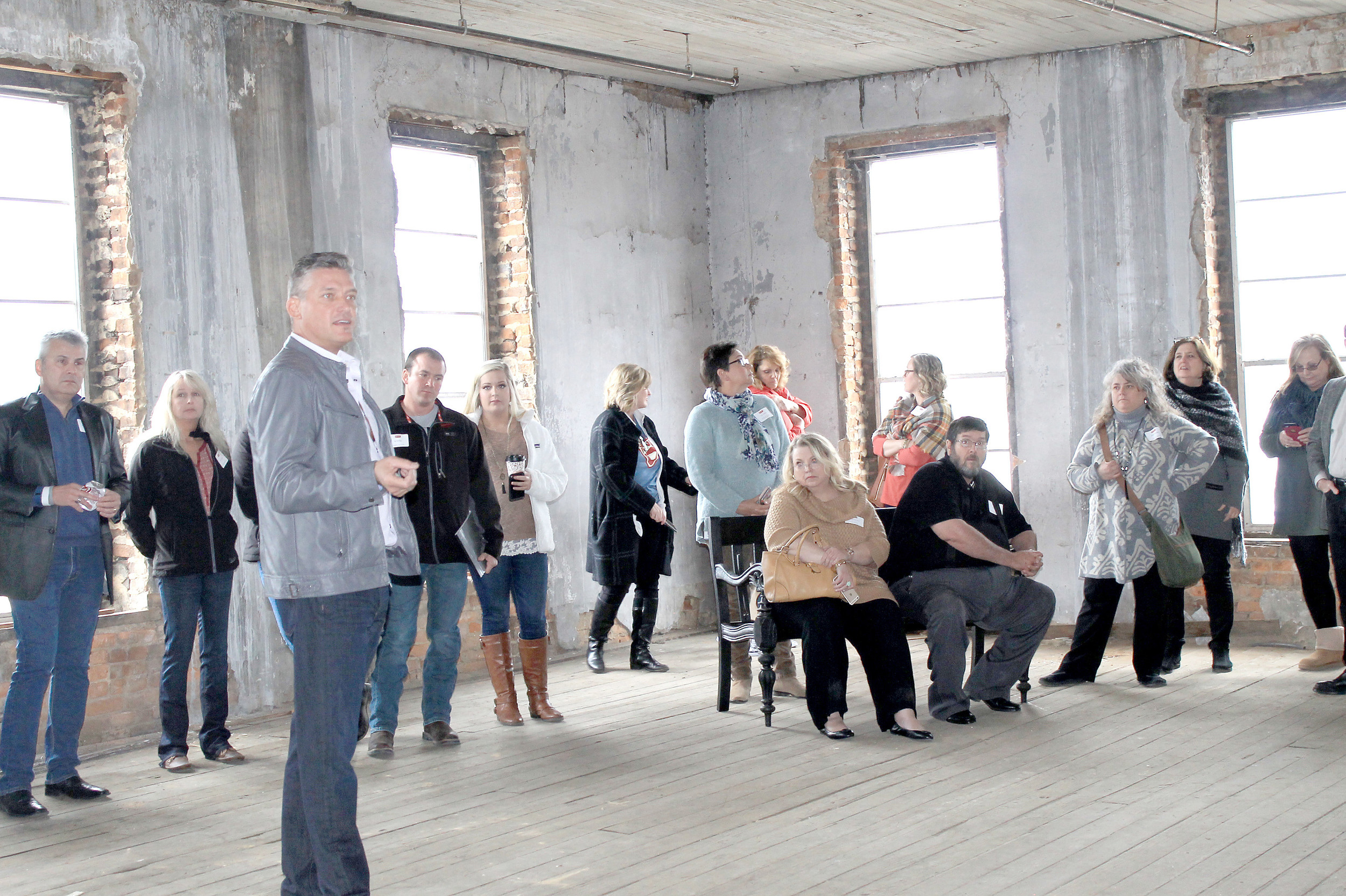 Consultant Ron Drake discusses the loft possibilities above Los Reyes Grill with Main Street directors from around the state on Tuesday. Daily Mountain Eagle - Jennifer Cohron