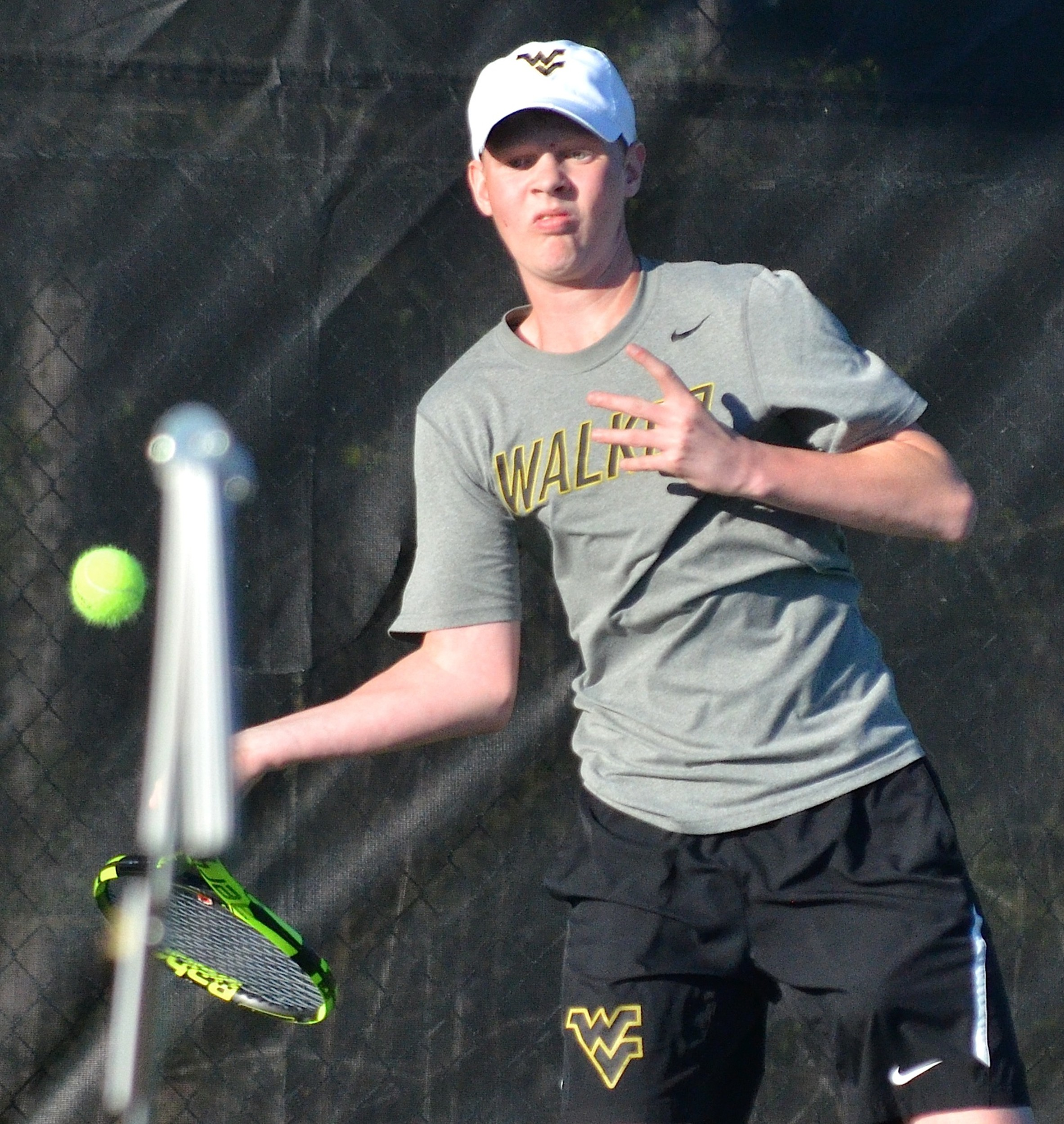 Walker's Mason Woodman won the No. 3 single section title at Valley Park on Tuesday. The Vikings swept through the tournament and will play at the state tournament next week.