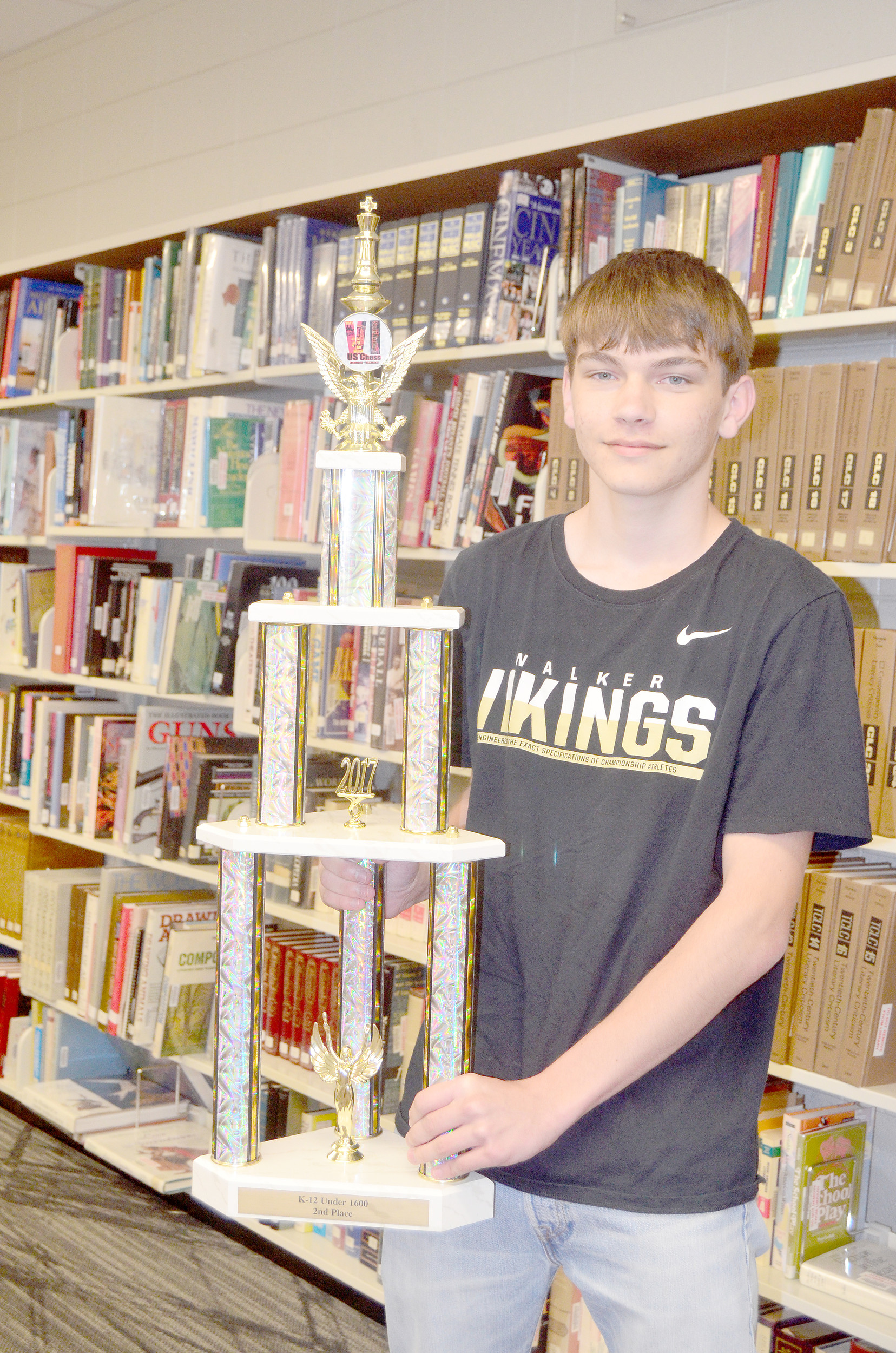 Jasper High School junior Calen Stewart poses with his second place trophy from the 2017 Chess SuperNationals. Stewart recently earned a perfect score of 36 on the ACT — a feat only a few students achieve each year. Daily Mountain Eagle - Lea Rizzo
