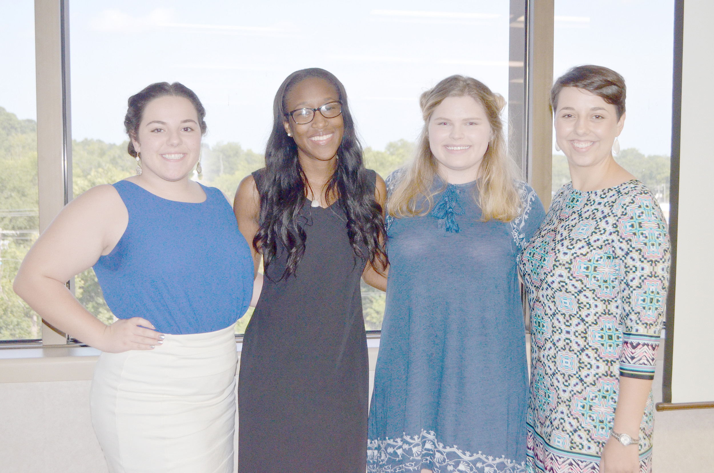 University of Alabama students spent their summer as interns at various nonprofits in Jasper. Pictured, from left to right, Kimberly Oliveira, Brittany Grady, Jenna Minser and Anastasiya Titarenko. Daily Mountain Eagle - Nicole Smith