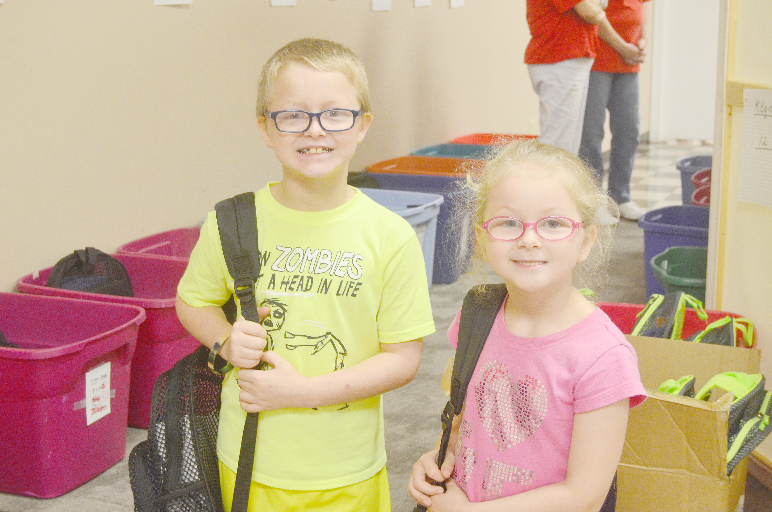 The Mission of Hope in Dora gave away backpacks filled with schools supplies to 100 children on Thursday morning. Daily Mountain Eagle - Lea Rizzo