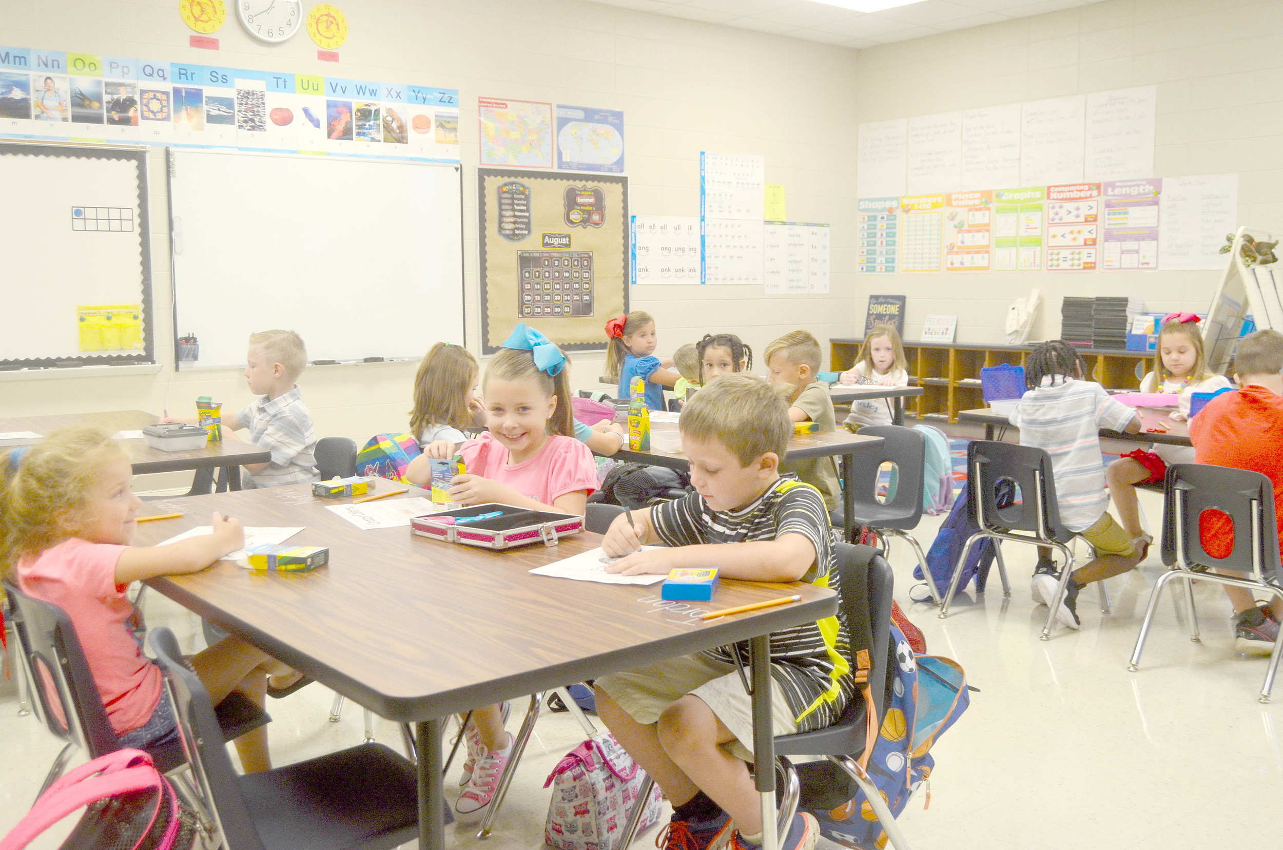Close to 700 students began their new school year on Monday at Sumiton Elementary School. These first graders were excited to get back to work as they spent the first few minutes of class Monday morning coloring.  Daily Mountain Eagle - Lea Rizzo