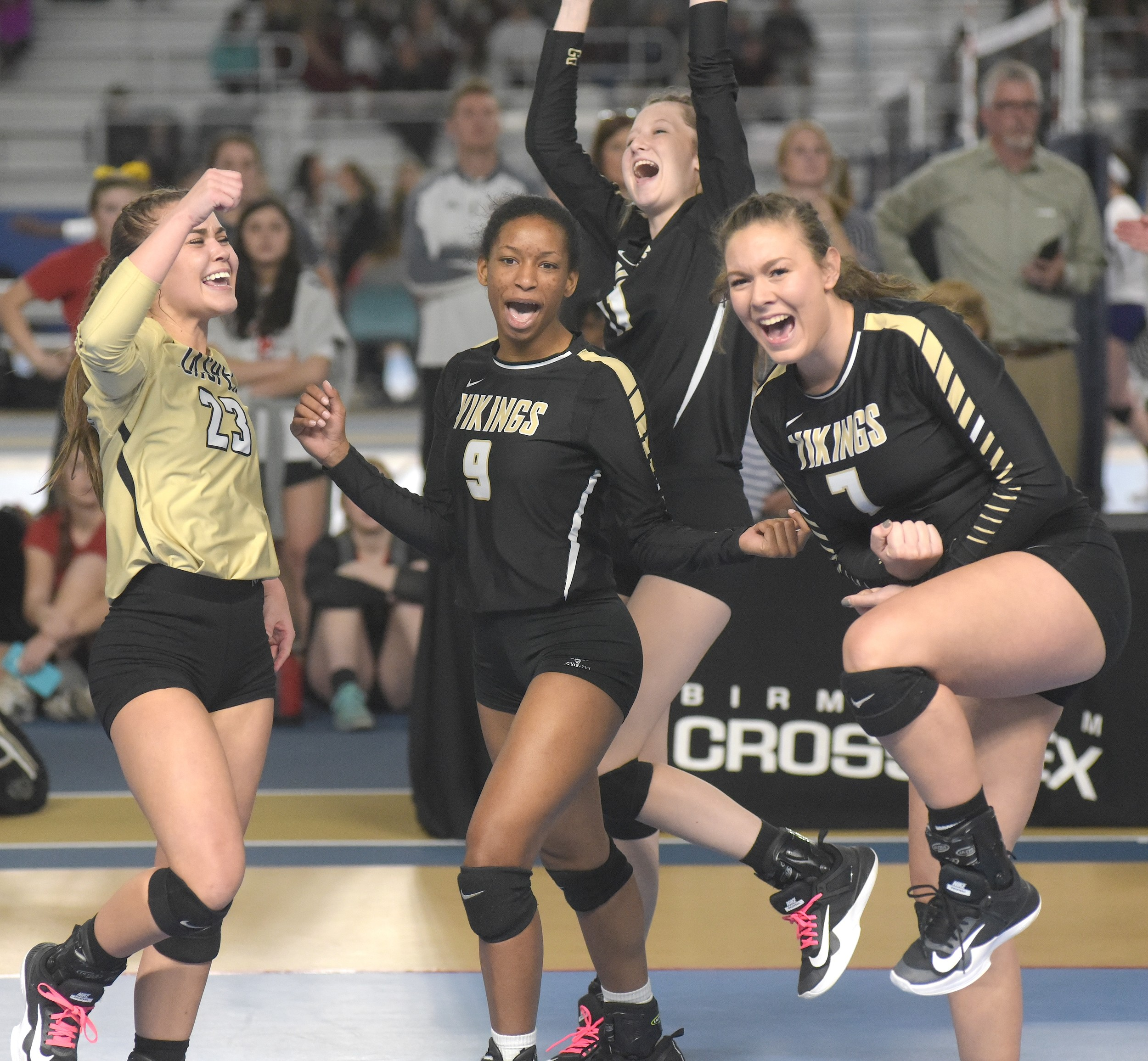 Jasper High School volleyball players, from left, Abby Trotter, Kelsey Shelton, Morgan McClendon and Khloe Kimbrell celebrate following the Vikings' victory over Helena at the State Volleyball Tournament Wednesday in Birmingham.