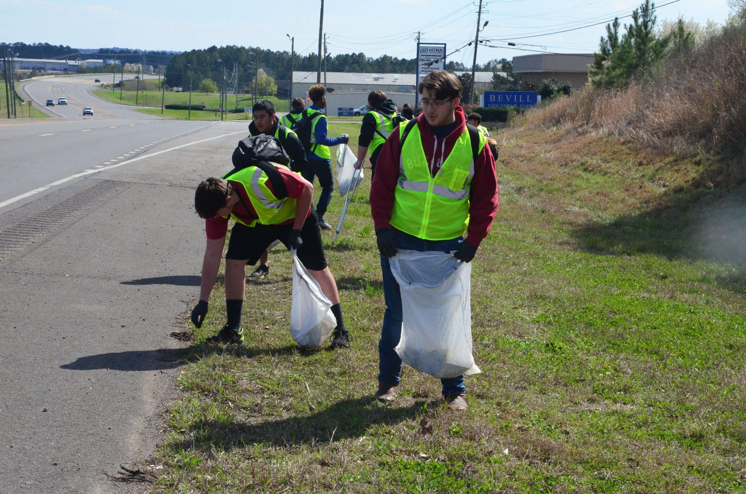 Jasper High football players and coaches spent more than an hour picking up trash as a part of the Clean as a Whistle campaign in the city.
