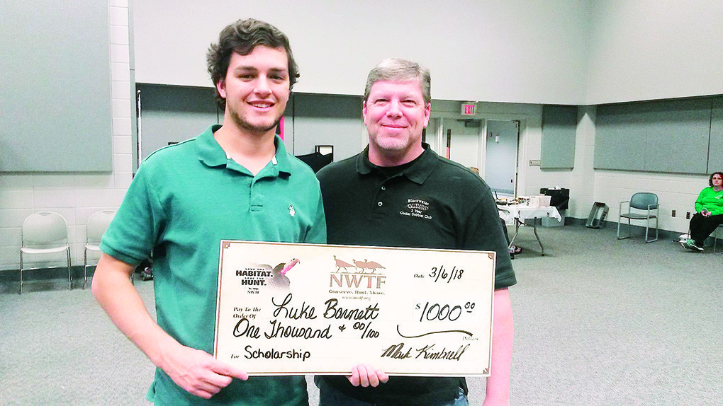The National Wild Turkey Federation Walker County Chapter recently presented Luke Barnett, a senior at Curry High School, with a $1,000 scholarship to help further his education. Barnett is pictured above at left with a member of the local NWTF chapter, Trent Kennedy.