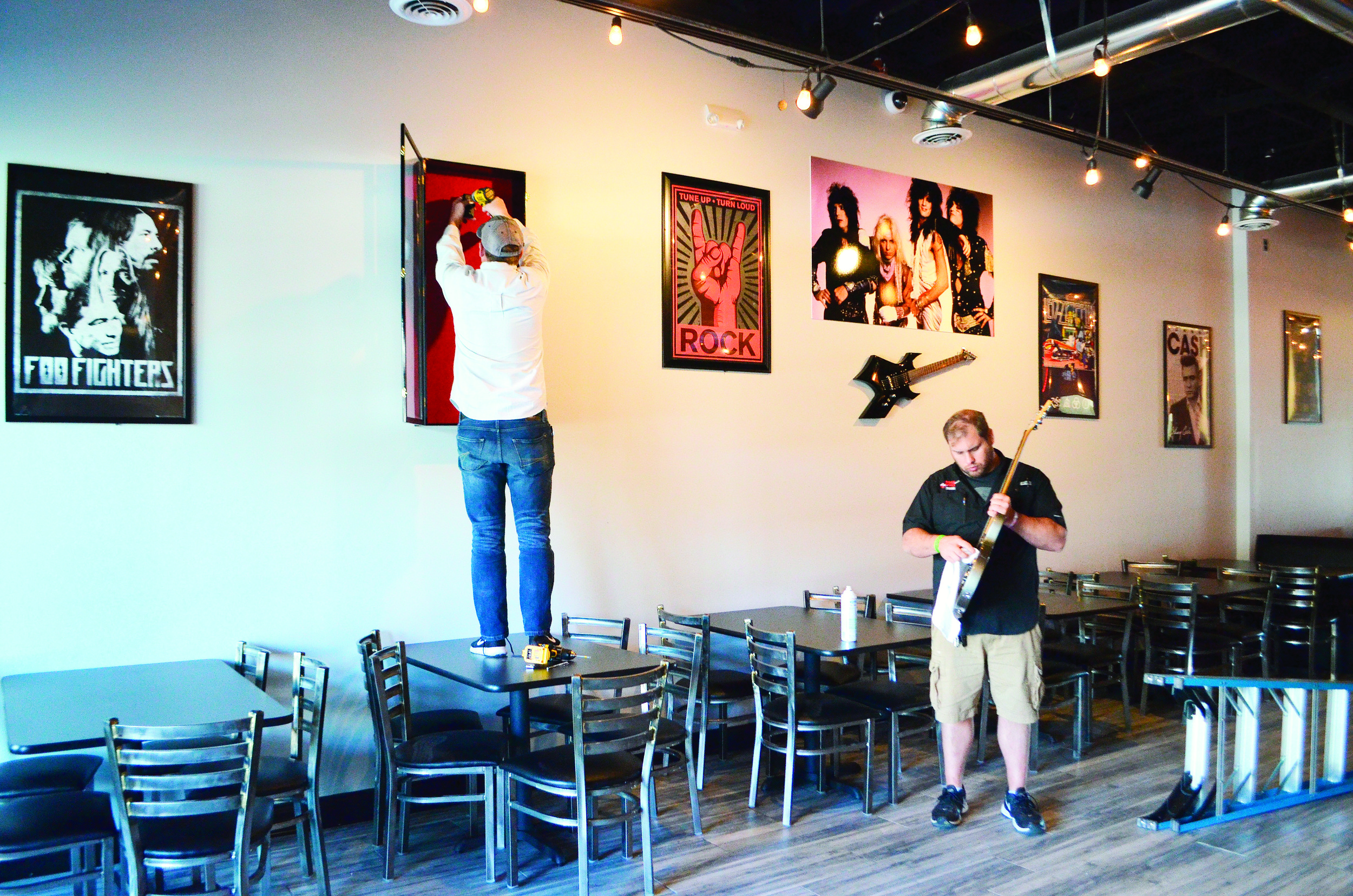 Owner Ryan Hallmark and Regional Manager Dalton Reaves work on the inside of Rock N Roll Sushi last week.