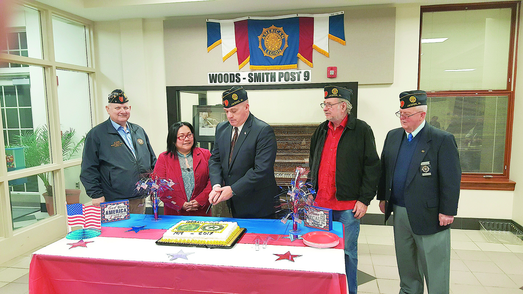 "Members of American Legion Woods-Smith Post 9 in Jasper cut a special birthday cake during their February meeting in honor of the American Legion's 99th Birthday Celebration. From left to right are Post Adjutant James ""Jay"" Snow, Auxiliary Deputy Commander Romalyn Aaron, Post Commander Charlie T. Cook, Post Deputy Commander Gary A. Hallmark, and Chaplain Larry B. Stewart."