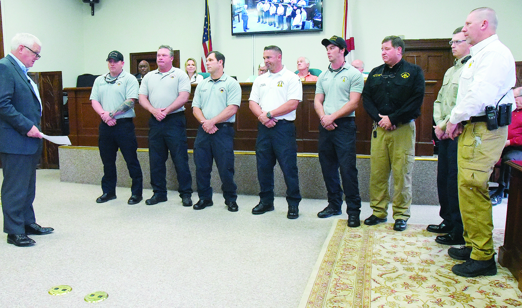 Jasper Mayor David O'Mary, at left, recognizes members of the Jasper Fire Department for their work in saving the life of a Jasper man two weeks ago.