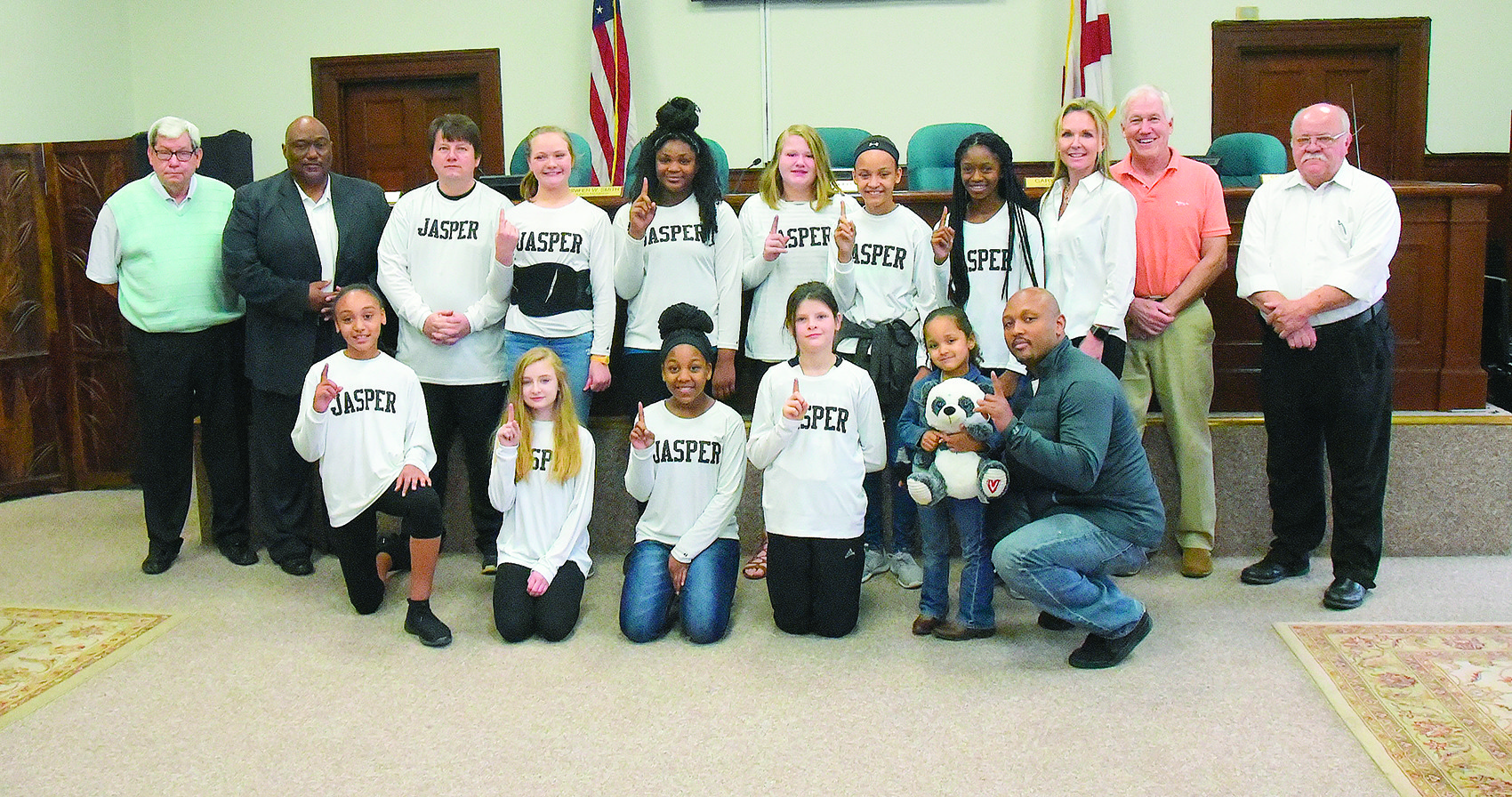 Members of a Jasper Parks and Recreation Department 11-and-under girls softball team were recognized Tuesday for recently winning an Alabama Recreation and Parks Association state basketball tournament.