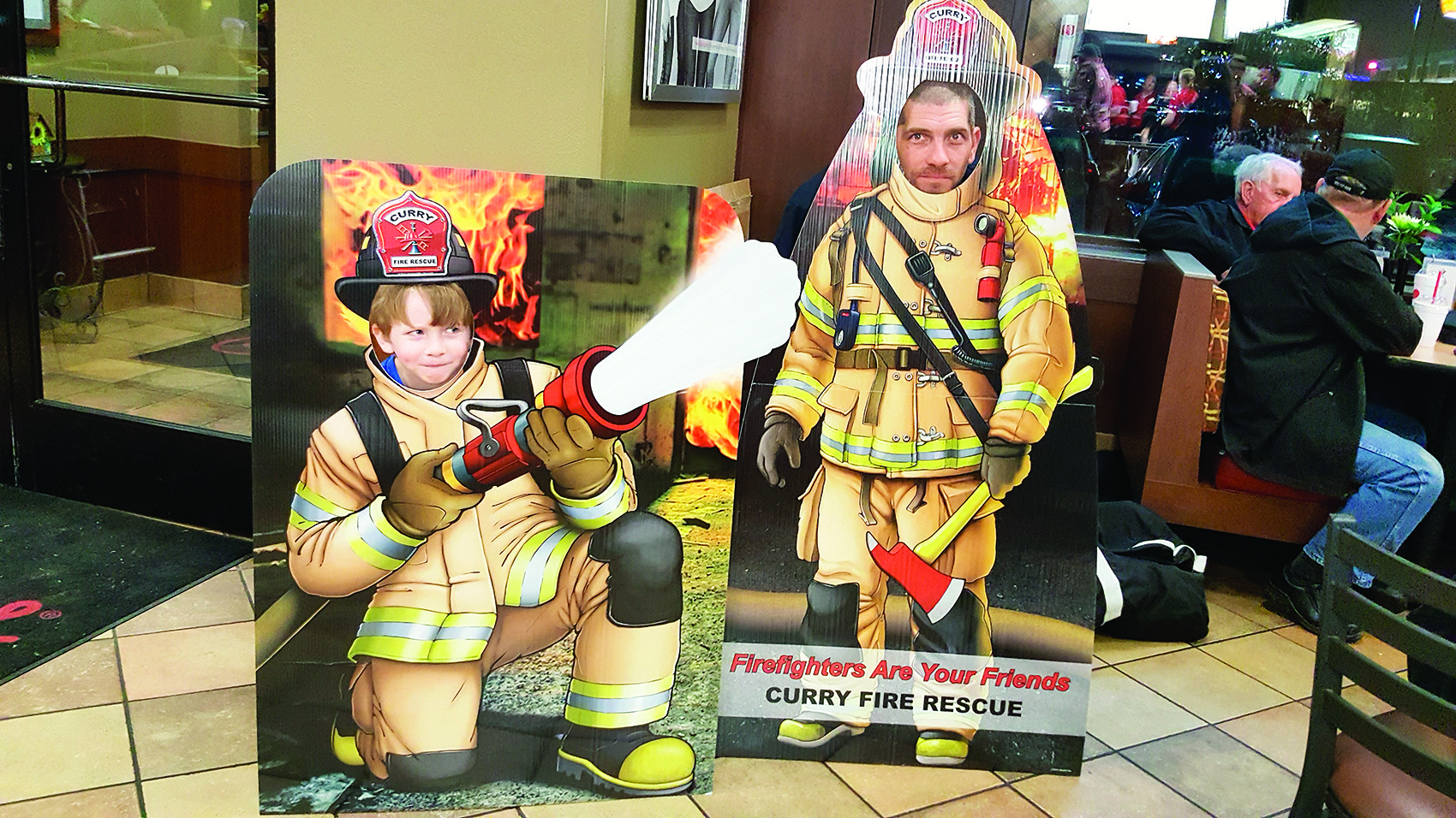 Tucker Reed Gaines and his father, Tim Gaines, a volunteer firefighter with the Curry Fire Rescue, had a little fun with the Curry Firefighter Standups during the second anniversary celebration of the Chik-fil-A Firefighter Aopreciation Day.
