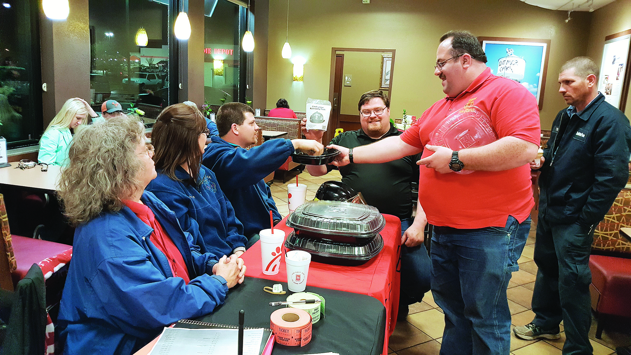 Members of Curry Fire Rescue draw for the door prizes donated by Curry Fire Rescue and Chik-fil-A for the second Anniversary Celebration of the Chik-fil-A Firefighter Appreciation Day. Winners of the door prizes were: Chik-fil-A Fire Department Party  went to Becky McCullar with Thach Volunteer Fire Department; Chik-fil-A Meals for a year went to David Box with Dora Fire Rescue; Firefighter Accessory Pack went to Ottis Burttram with Saragossa Volunteer Fire Rescue; and the Firefighter Helmet Light went to Kimberly Martin with Town Creek Volunteer Fire Department.