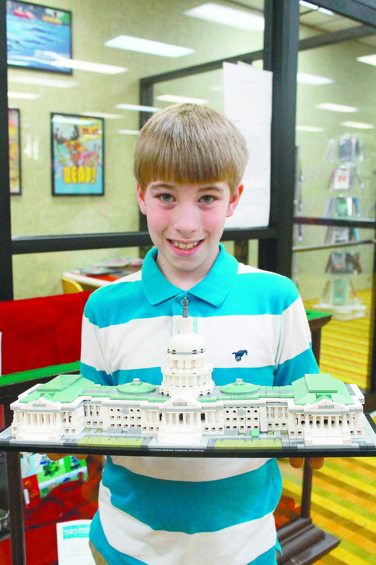 Jaylon Hill, 9, holds the LEGO model of the U.S. Capitol that he completed in four days. His collection of architectural LEGOs are on display at Jasper Public Library through the end of April.