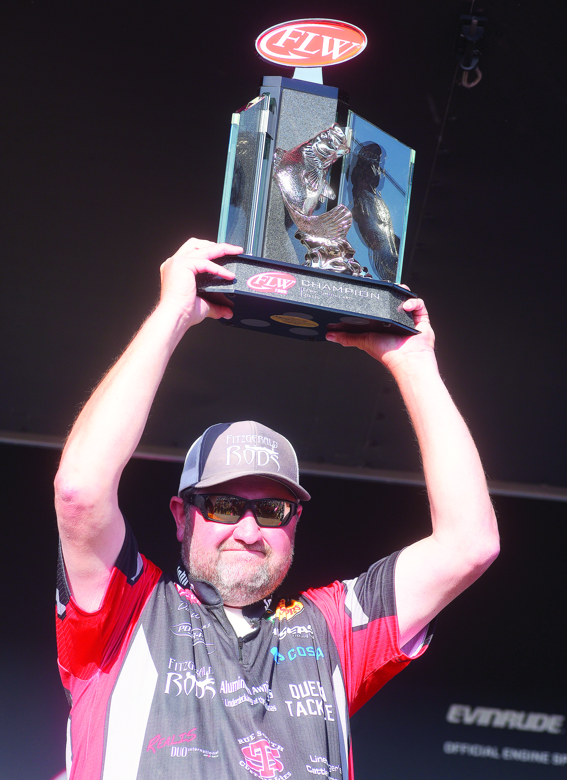David Williams of Maiden, N.C.,  hoists the trophy after winning the FLW Tour event on Lewis Smith Lake. The win was the first on the FLW Tour for Williams, who finished the four-day tournament with 64 pounds, 9 ounces.