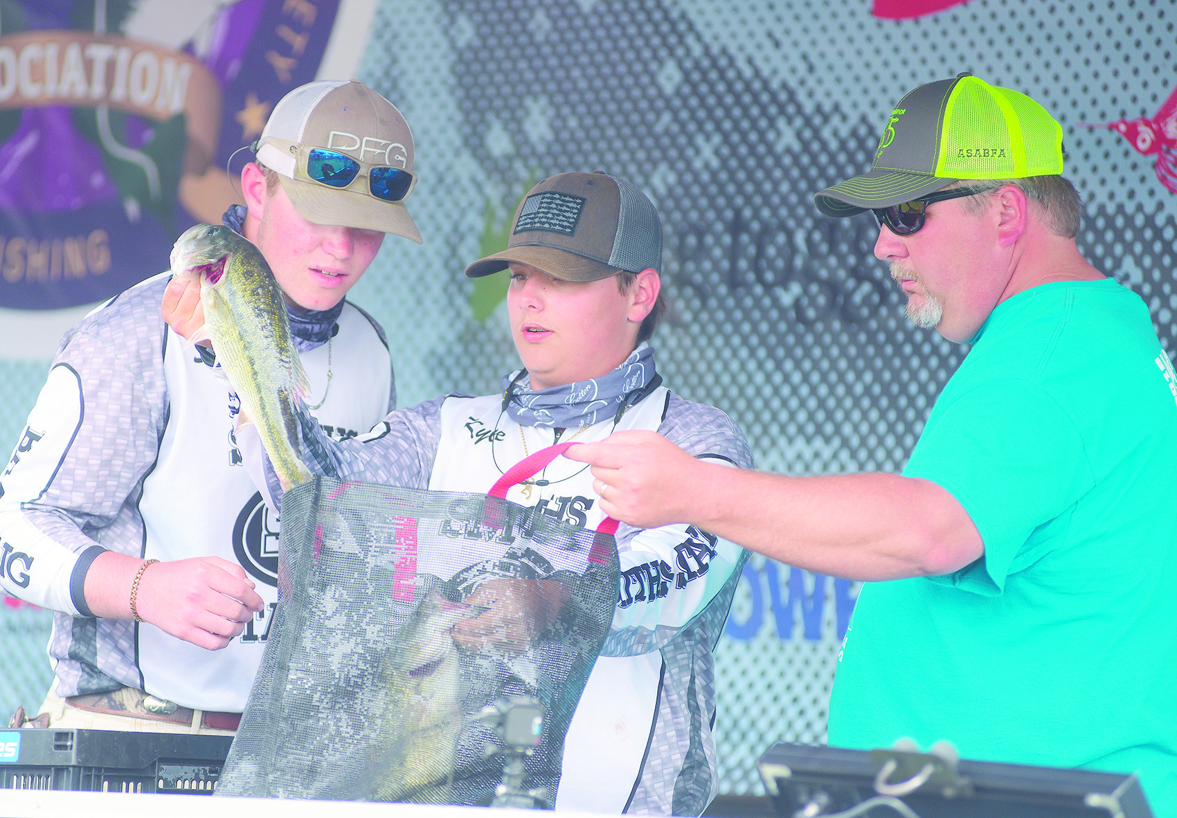 High school anglers from Smiths Station, above, and Chelsea, at right, high schools show off their catches from  