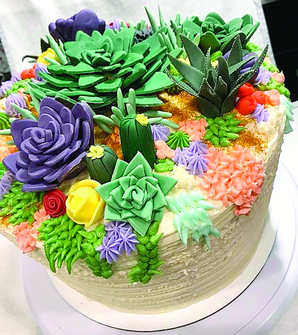 Pictured is a cake designed by Ani Piper and Kelly Rigsby to resemble succulents.