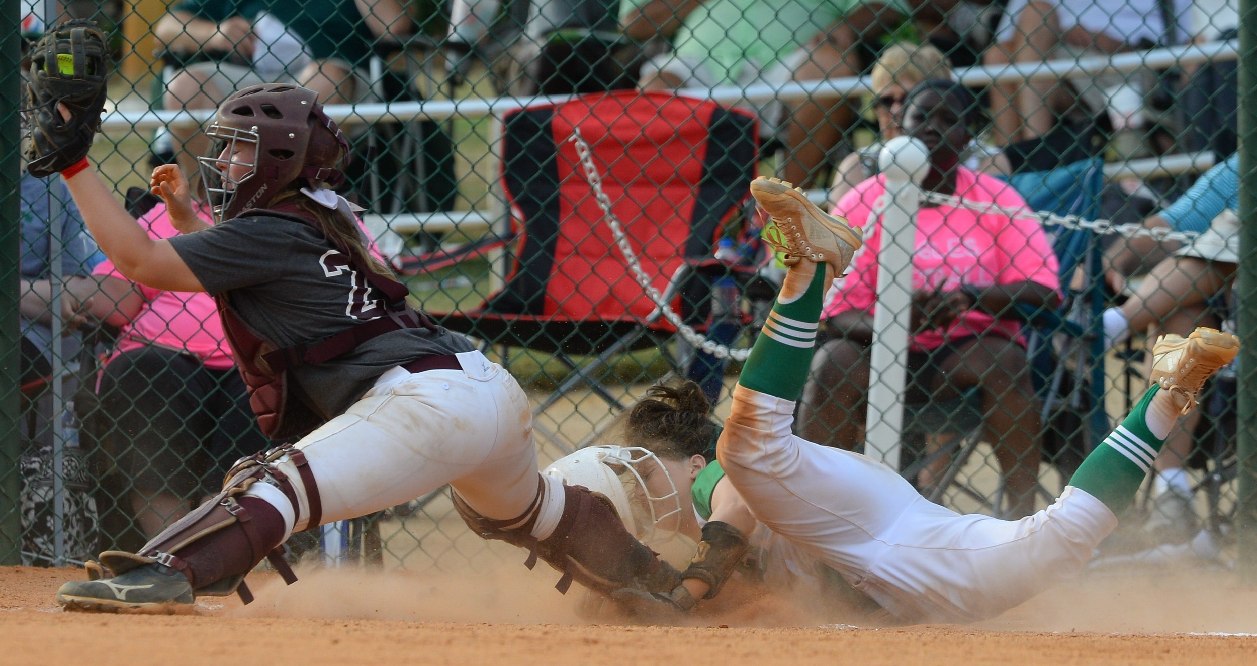 Sumiton Christian catcher Angel Whitlow comes up with the ball as a Brantley base runner slides into home during their game at the State Softball Tournament on Thursday. The Eagles fell to Brantley 5-1 in the championship game.