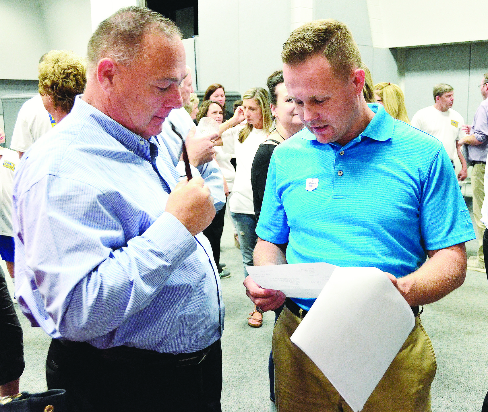 Nick Smith, at right, and Walker County coroner Joey Vick look over vote totals from Tuesday's Republican primary election at the Jasper Civic Center. As of now, Smith and current Walker County Sheriff Jim Underwood will meet in a runoff on July 17. That could change once provisional ballots are counted next Tuesday.