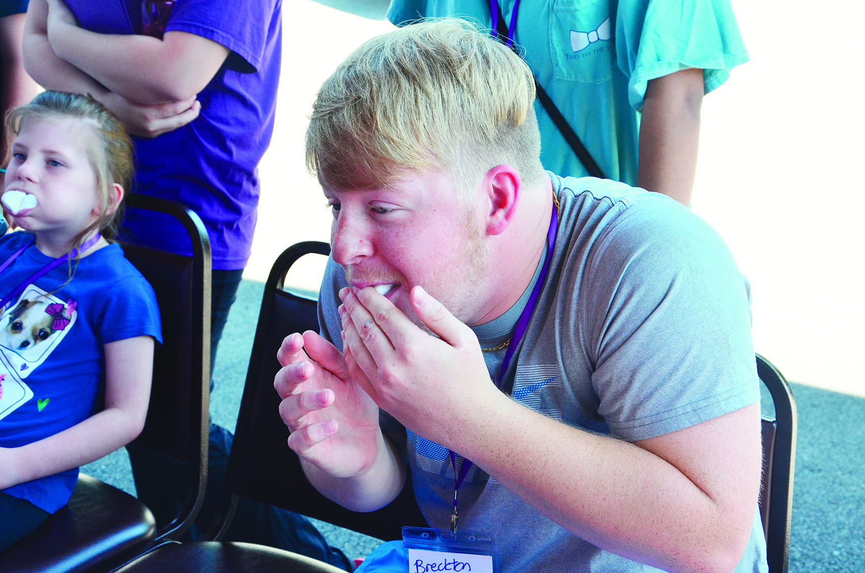 Breckton Wilkinson attempts to hold marshmallows in his mouth while playing a game at Camp COOL. Wilkinson is one of the counselors this year.