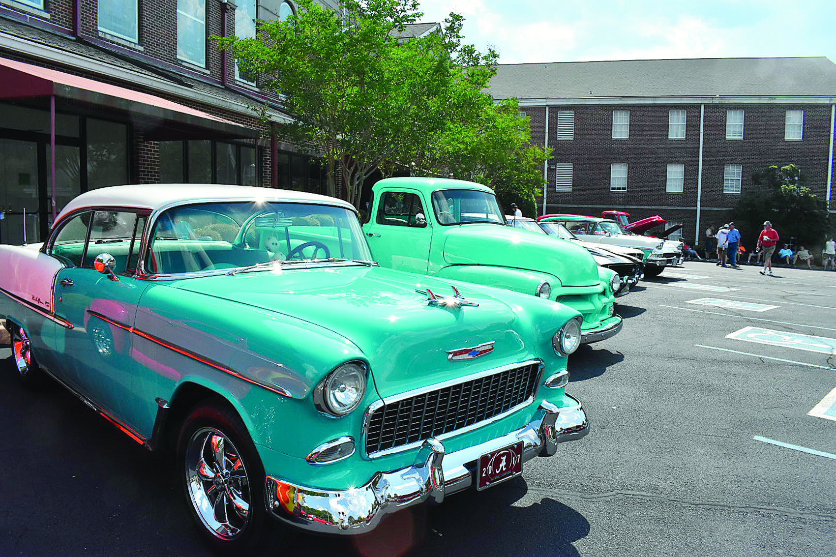 Jasper's First Baptist Church held its second annual community cruise-in and cook-out at the church parking lot on Sunday, with cars , food and children inflatables.