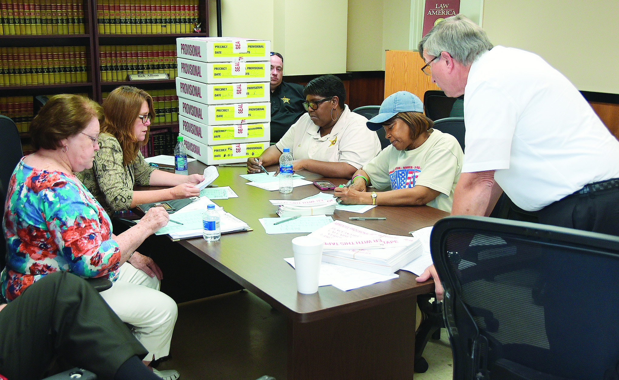 Walker County Probate Judge Rick Allison, at right, and other officials go over the results following the counting of provisional ballots from last week's primary election in Walker County.  From left are Linda Ensor, chairman of the Walker County Republican Party; Walker County Circuit Clerk Susan Odom; Myrtle Jackson of the Walker County Sheriff's Office; and Shirley Mitchell, a representative of the Walker County Democratic Party.