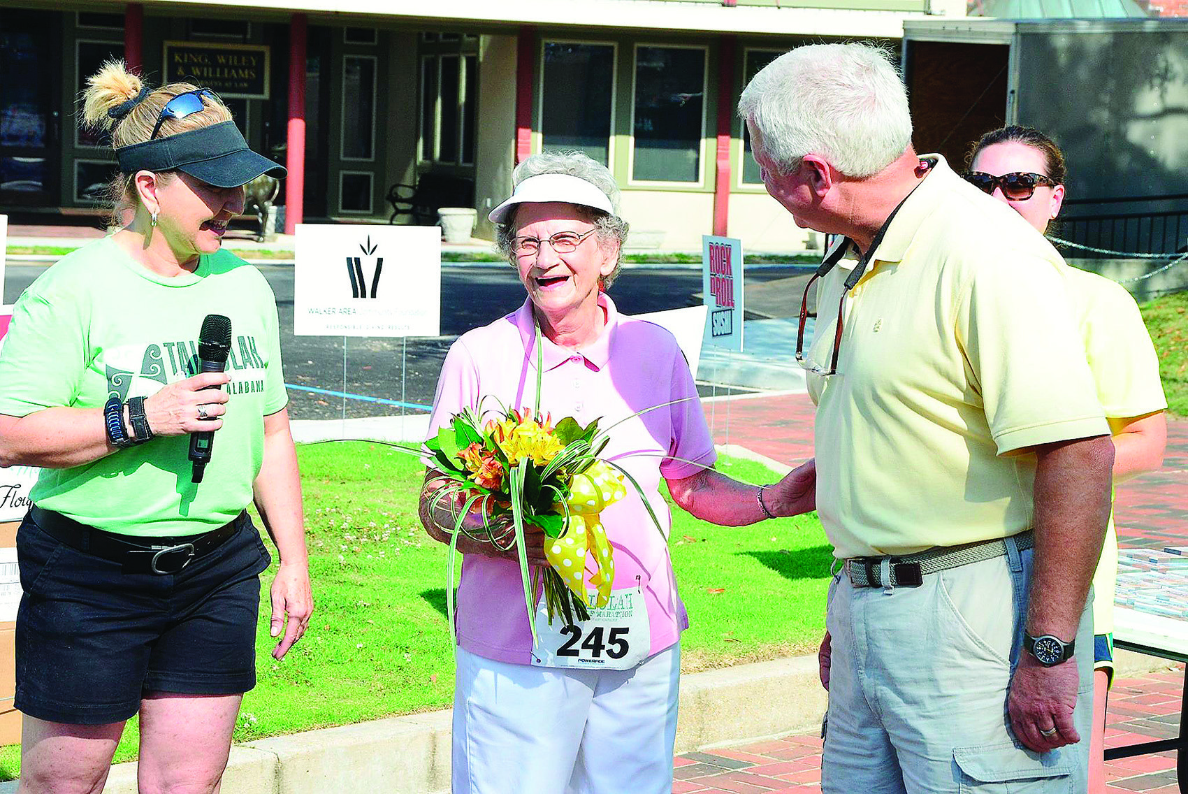 Mayor David O'Mary presents Ruth Ingle with a bouquet of flowers after Ingle, 82, finished the Tallulah 5K in slightly over 47 minutes on June 9. Also pictured is run organizer Angela Jo Harris.