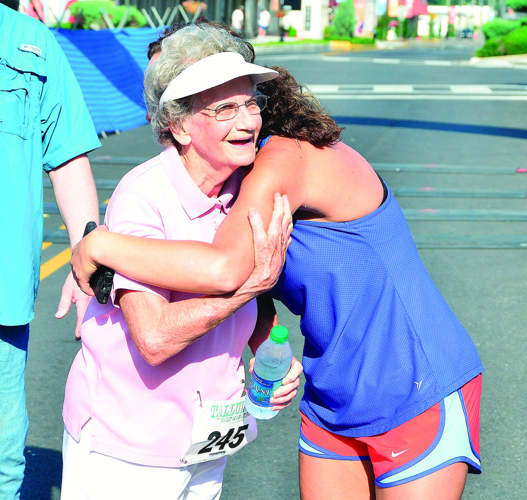 Ruth Ingle is embraced by April Butler, a local runner who accompanied her in the Tallulah 5K on June 9.