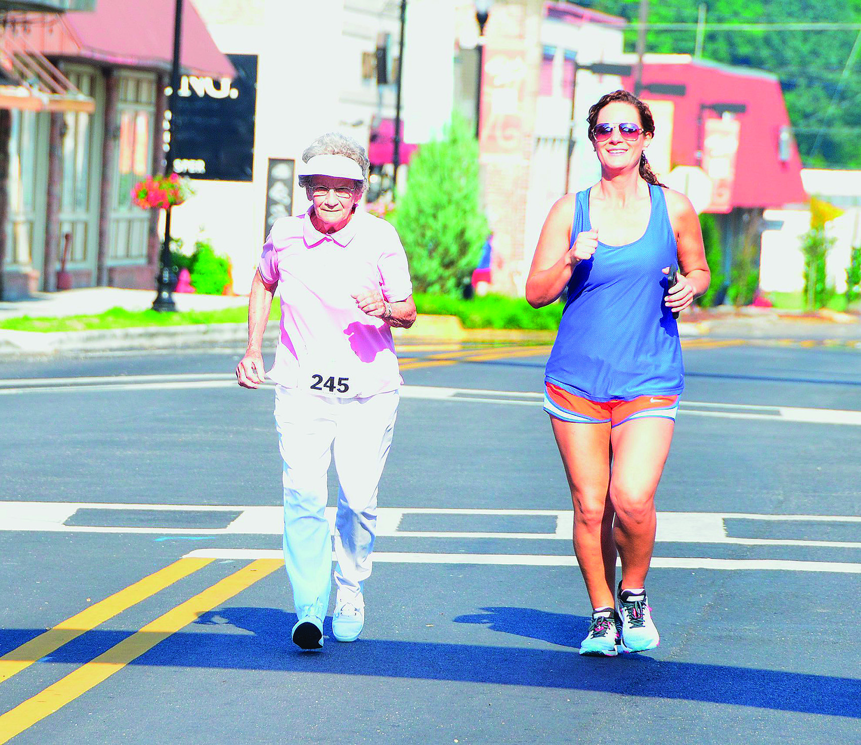 Ruth Ingle and April Butler trot through the streets of Jasper during the Tallulah 5K on June 9.