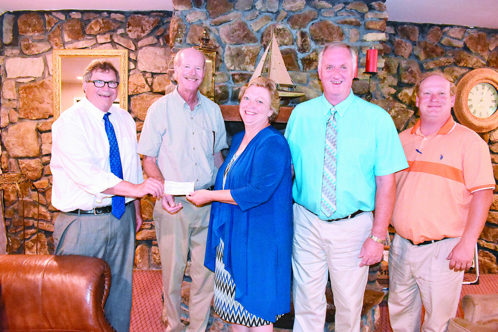 The Winston County Arts Council presented a $1,000 check to Lynn Elementary School at its June 25 meeting to use in its marking of the state's bicentennial. Shown in the presentation at Lakeshore Inn in Double Springs are, from left, state Rep. Tim Wadsworth, arts council treasurer Larry Welton, teacher Cynthia Tittle of Lynn Elementary School, Wayland Tittle of Lynn Elementary's Bicentennial Grant Committee and Winston County Commissioner David Cummings.