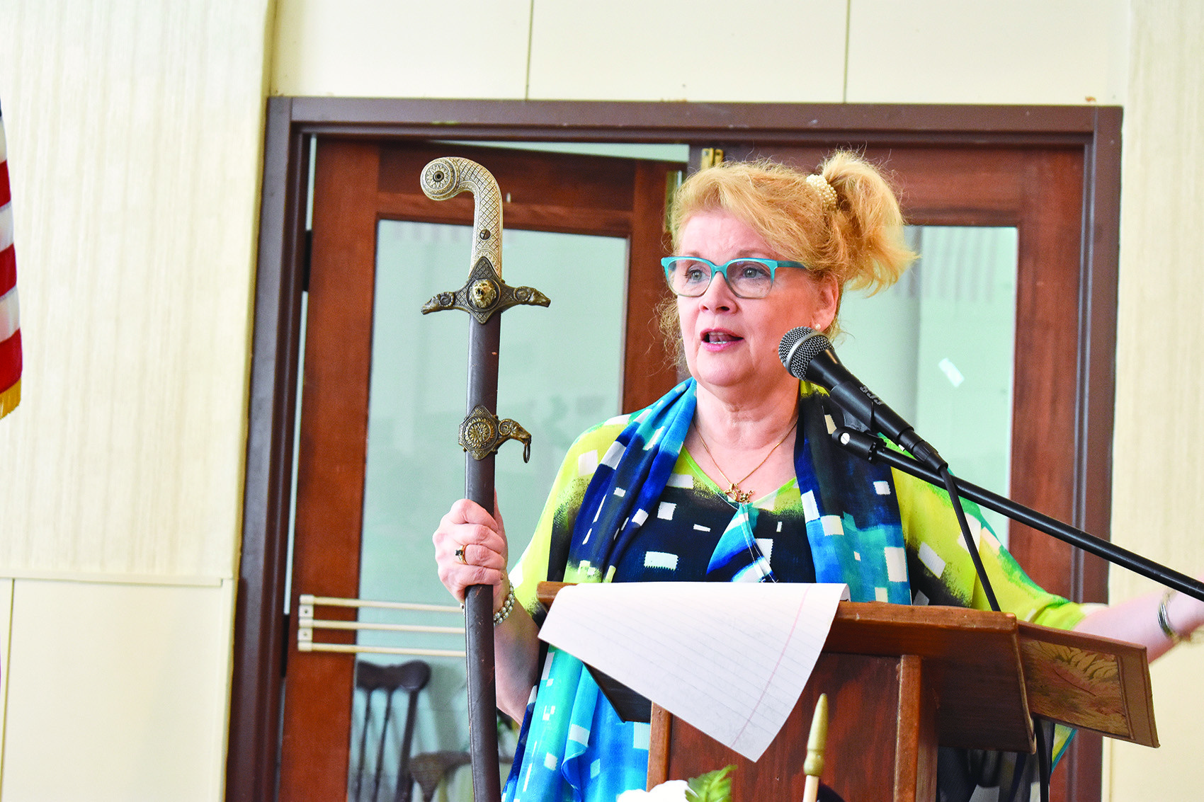Author Edie Hand holds a sword that helped give her inspiration when she thought about giving up on life during a speech to the Merry Hearts of Northside Baptist Church on Tuesday.