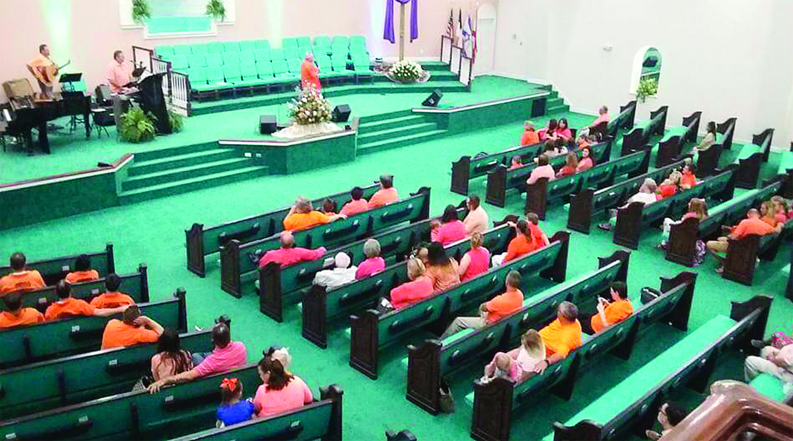 "Sanctuary Church of God held a ""Go Orange"" Sunday last year after inmates from Cordova Jail began attending services."
