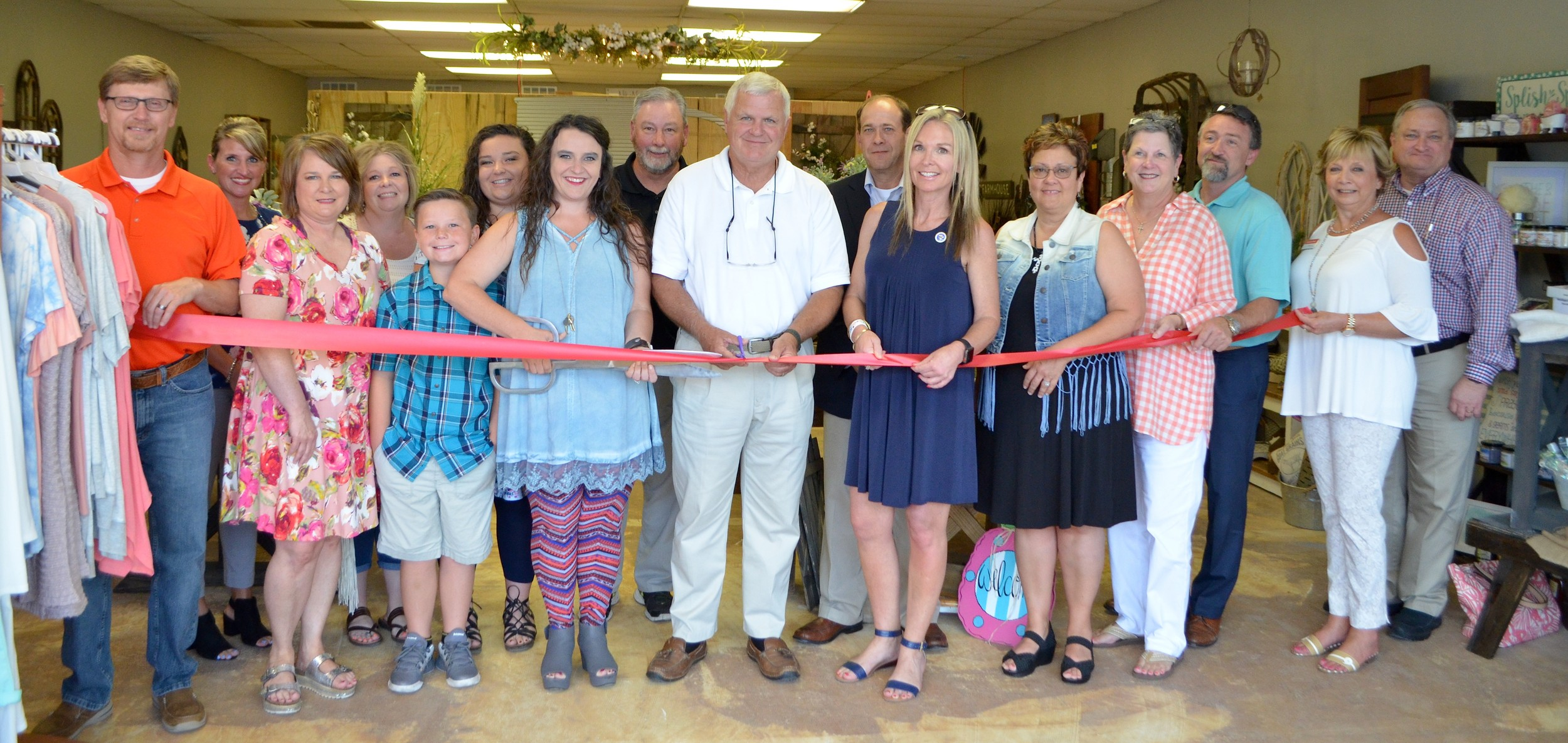 A ribbon cutting was held last Friday for the new location of The Tin Cup Market on Highway 78 East.