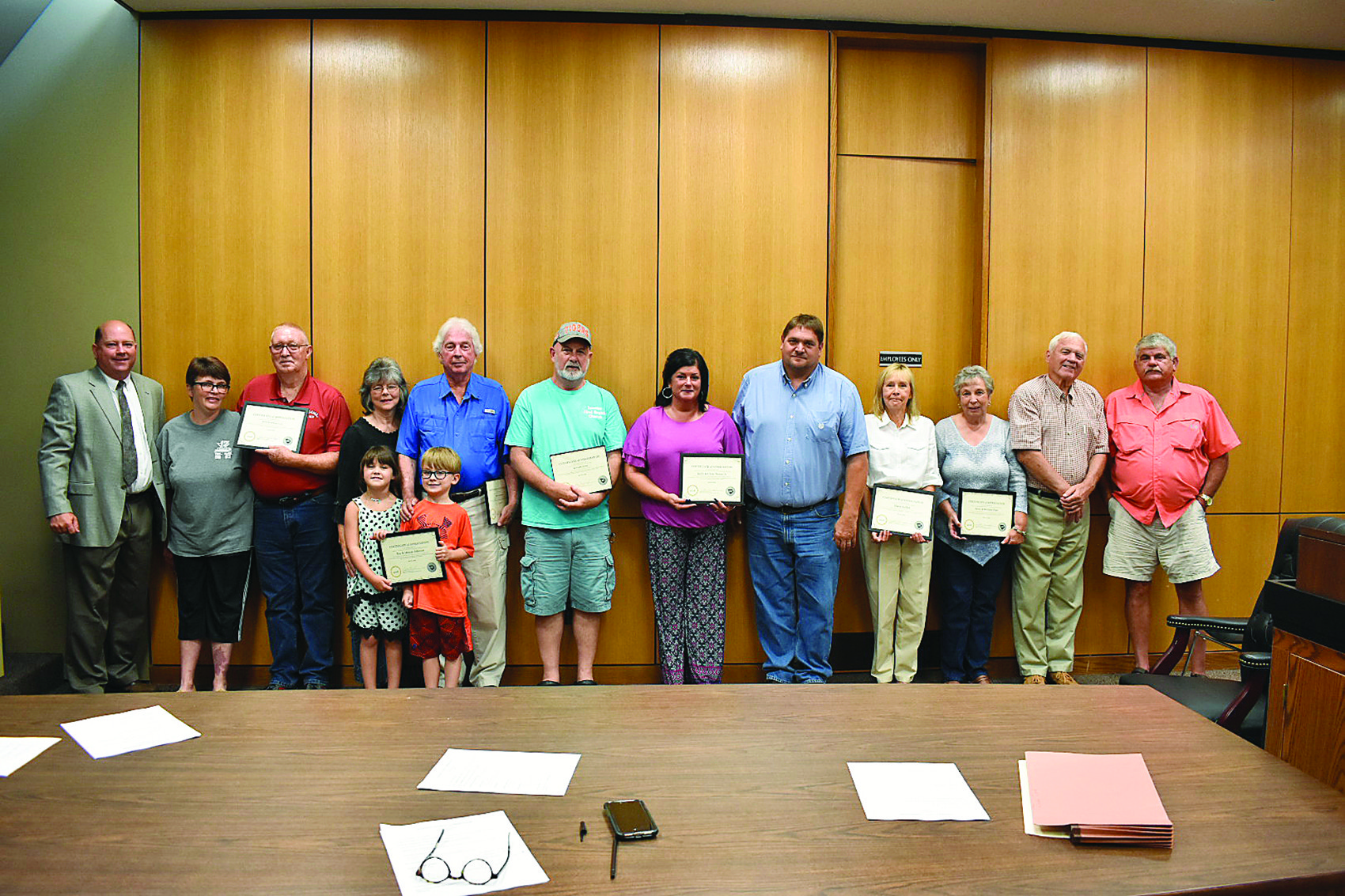 District 2 Walker County Commissioner Jeff Burrough (far left) presents certificates of appreciation to citizens who are helping to pick up litter in their areas. The presentation was made at Monday's night meeting of the commission.,
