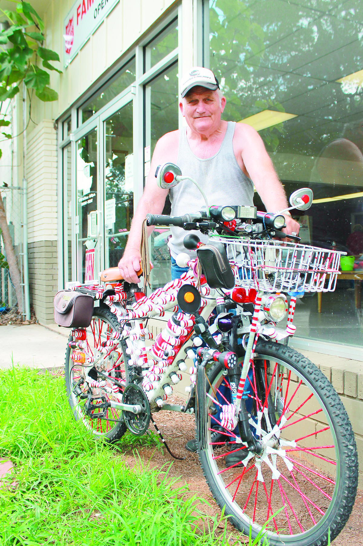 Lewis Ray Johnson, 75, stands with his unique bike outside of the Walker County Salvation Army building on July 9.
