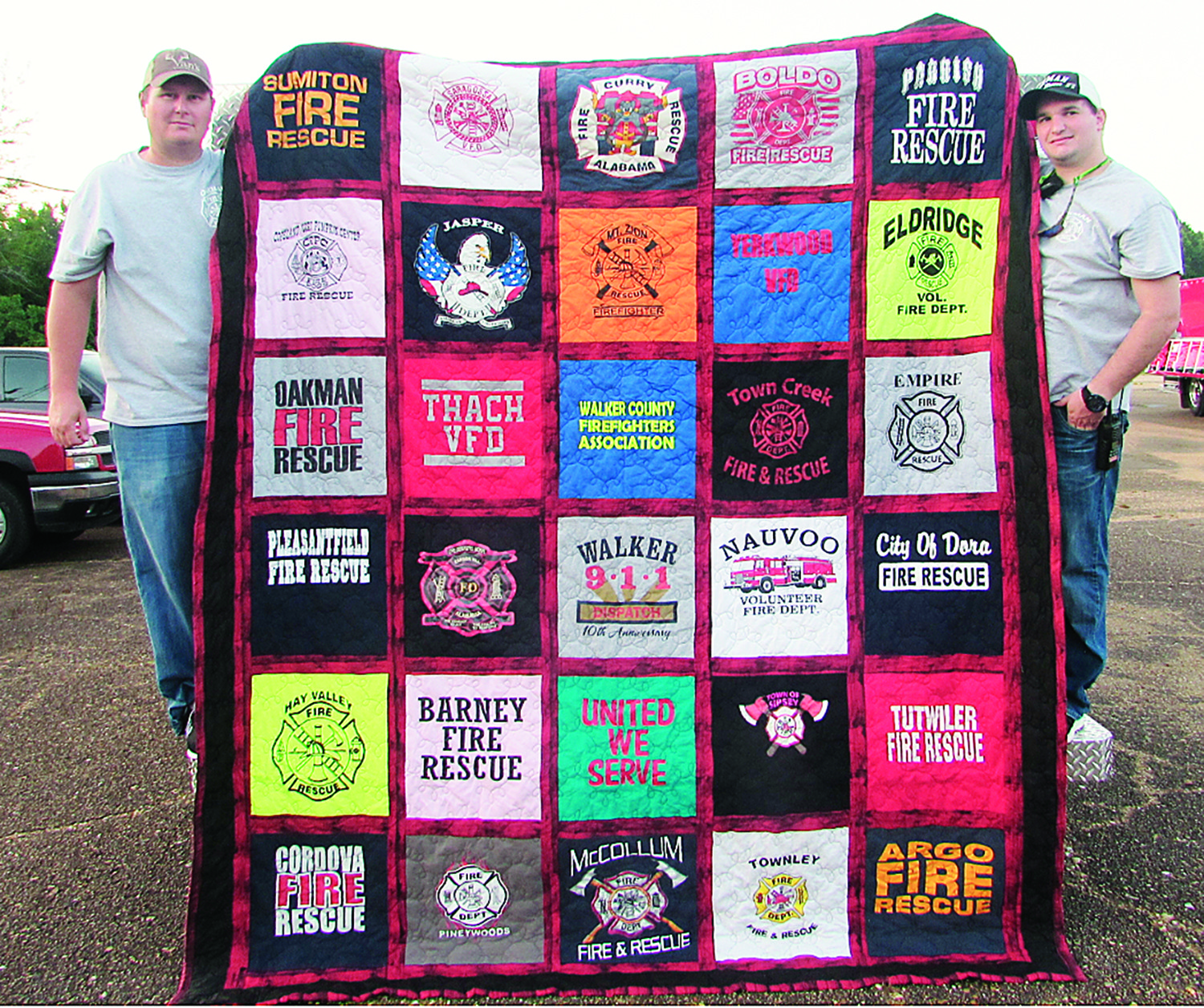 The Oakman Volunteer Fire Department was the lucky winner of the Walker County Firefighters Association beautiful T-shirt quilt. The quilt, which featured T-shirts from all 27 Fire Departments in Walker County, was given away during the WCFA meeting being held on Tuesday, July 10. The WCFA raised over $1,800 from the giveaway, which will be used to help fund training for all the fire departments. The WCFA would also like to thank all the ladies at Herman Baptist Church in Curry, who helped sew on the quilt  for this special fundraiser. Pictured above with the quilt are members of the Oakman Volunteer Fire Department - Fire Chief Shane Callaway and Firefighter Colt Courington.