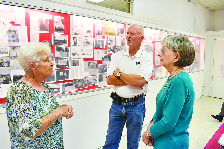 Eldridge Mayor Bobbie Jean Dodd, left, speaks on Tuesday with Dwight Hicks, center, of Jasper, a Walker County representative of Cawaco RC&D, and Councilwoman Martha Tiddle in the town's museum, located in the town's community center. The town celebrated a Cawaco grant that was used to improve the center.