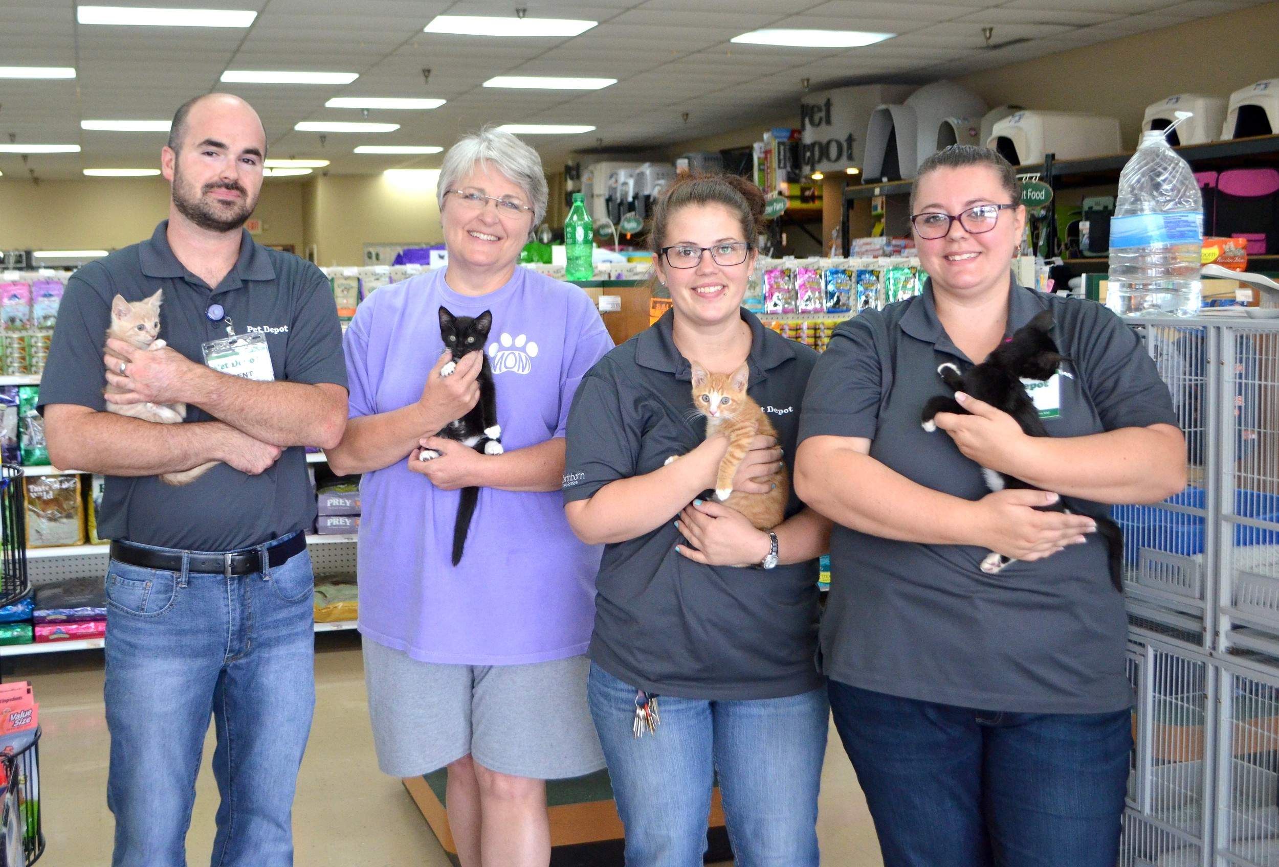 Over 400 cats have been adopted through Pet Depot's Cat Adoption Center. Pictured, from left to right, Pet Depot Manager Brent Williams, Walker County Humane Society Board Director Susie Vann, Pet Depot employee Whitney Lacey and Pet Depot Assistant Manger Madi Minderhout.