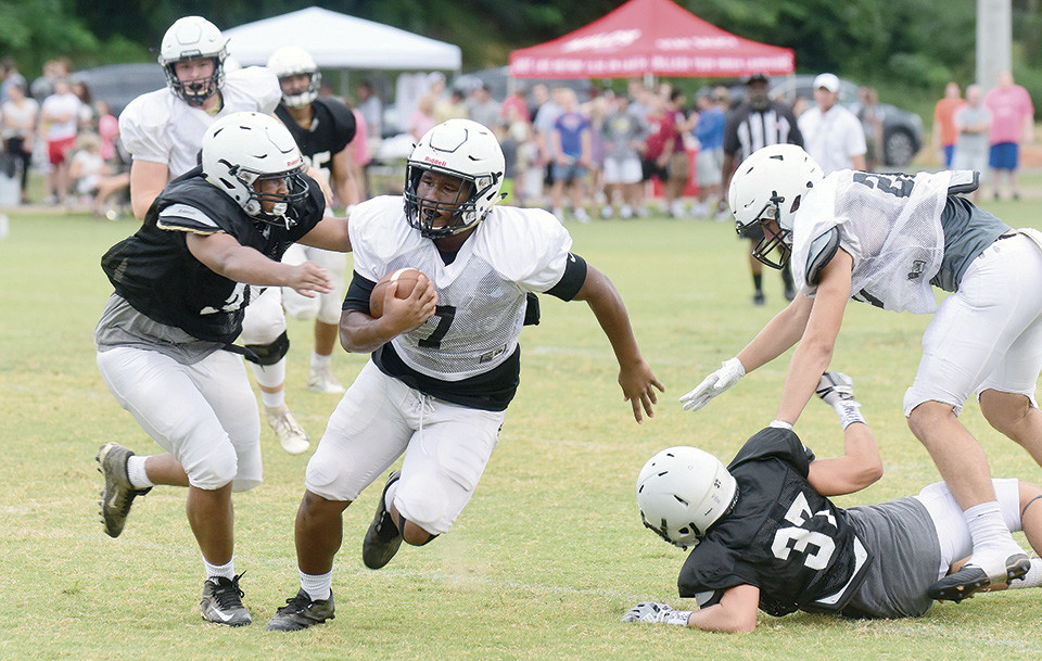 Jasper running back Kaden Shelton (7) tries to escape the grasp of a defender during Thursday's 'Meet the Vikes' scrimmage on the practice field next to Kiro-Gambrell Field.   The Vikings open the regular season at Cullman next Thursday night at 7 p.m.