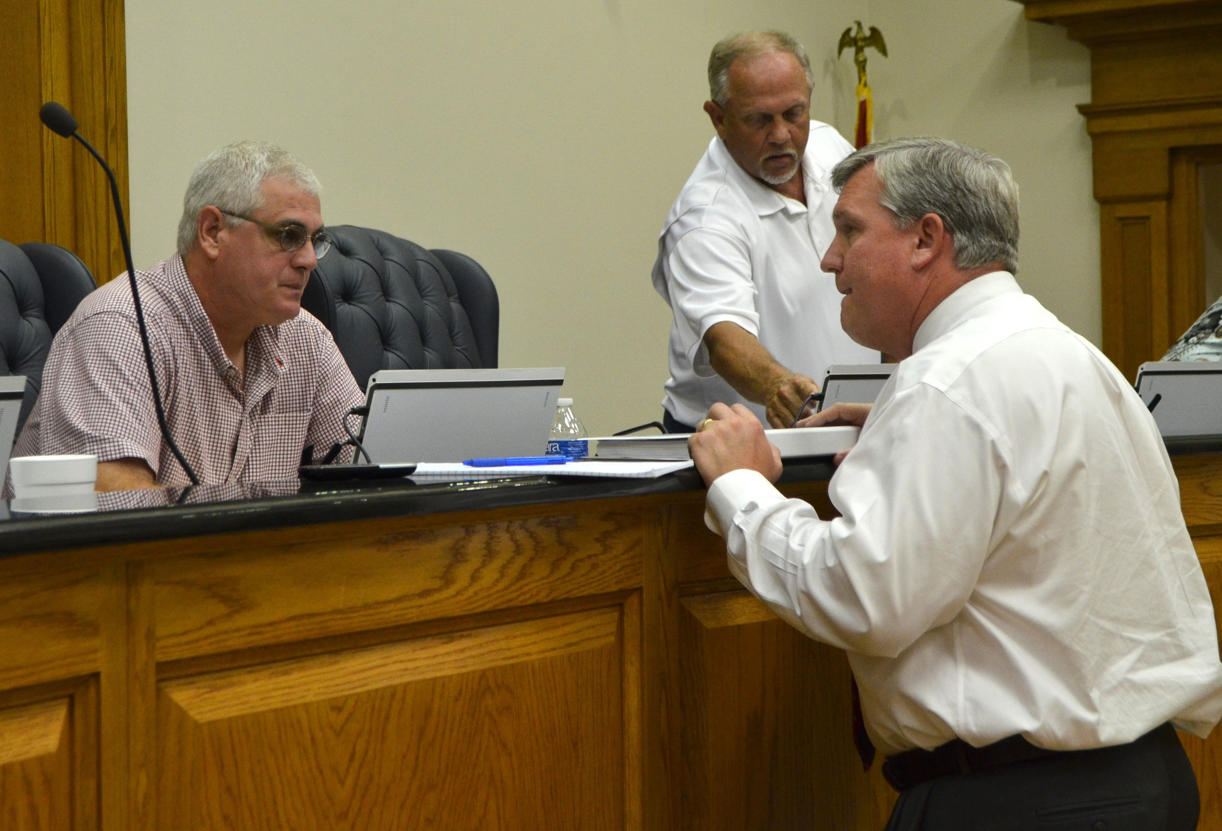 Interim Superintendent of Walker County Schools Dr. Joel Hagood, at right, talks to board Chairman Brad Ingle Thursday night.