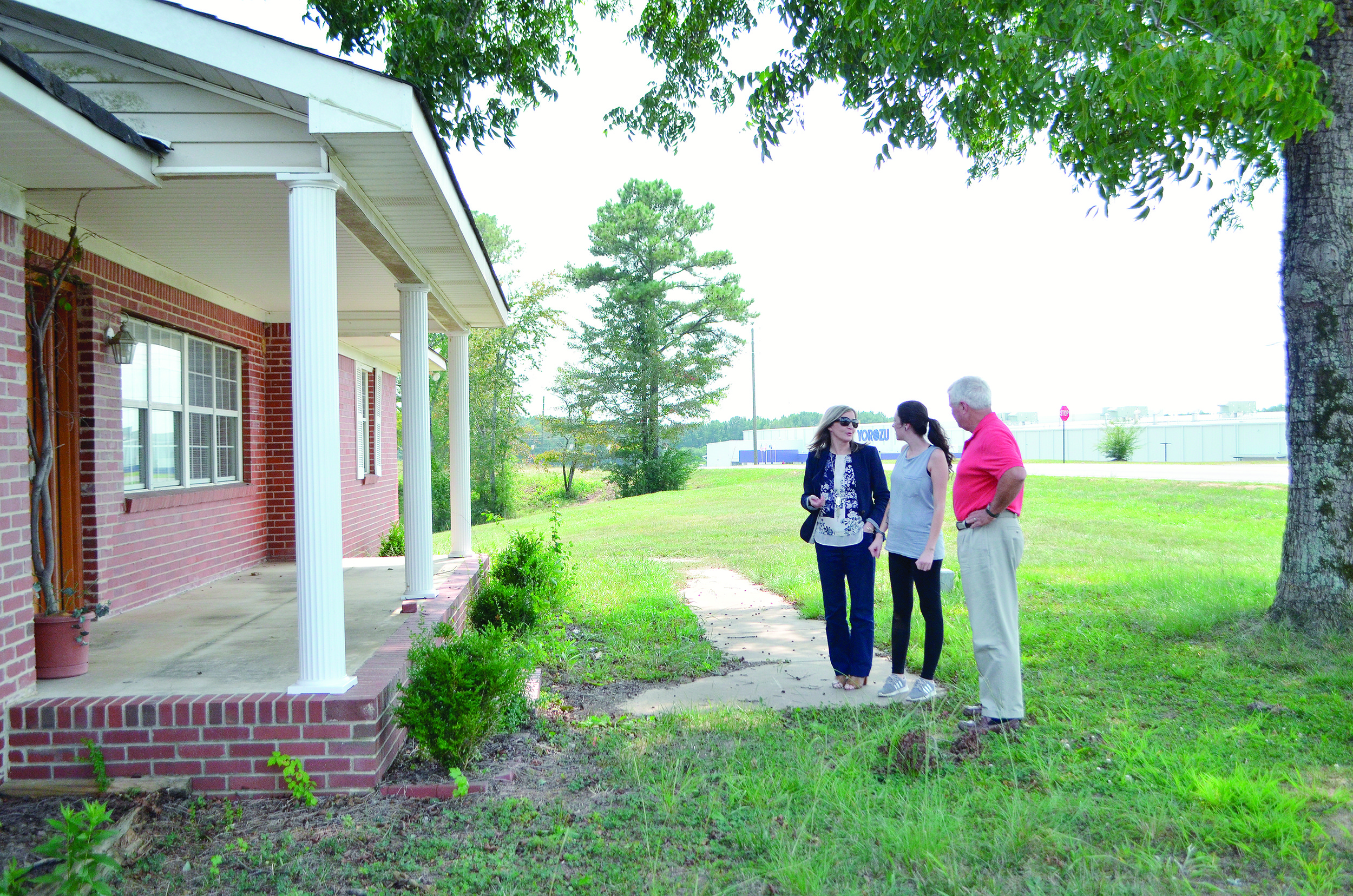 Jasper City Clerk Kathy Chambless, left, City of Jasper Animal Shelter Manager Jesika Pilgrim, center, and Jasper Mayor David O'Mary look at what could be the future home of the city shelter.