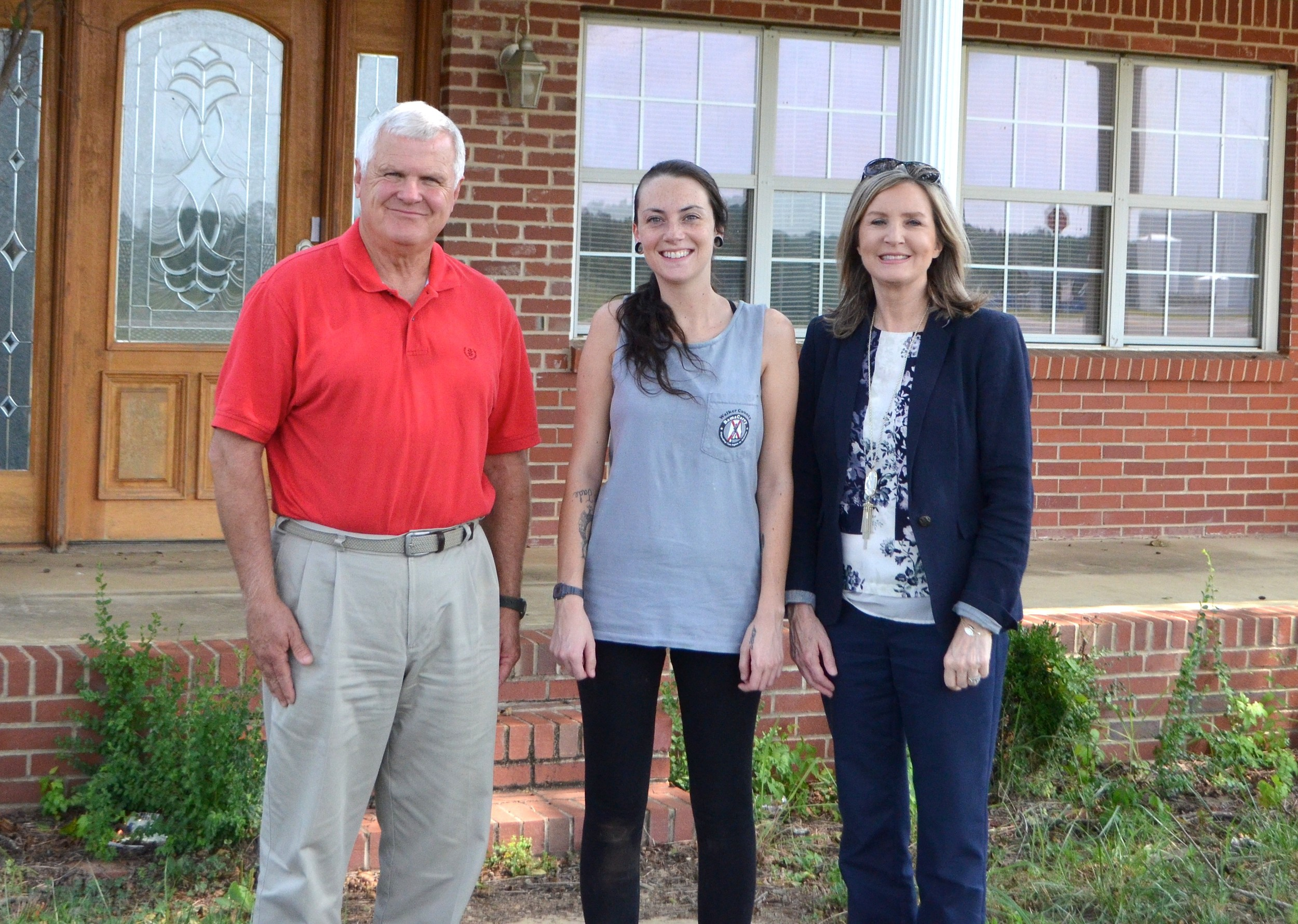 Jasper Mayor David O'Mary, left, City of Jasper Animal Shelter Manager Jesika Pilgrim, center, and Jasper City Clerk Kathy Chambless pose in front of the building that could house the city animal shelter.