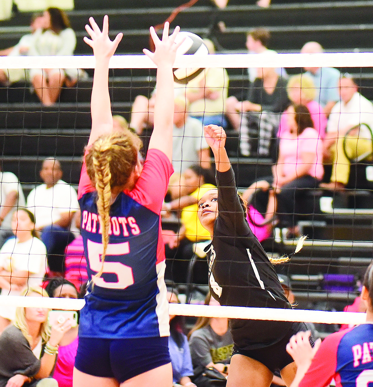 Jasper's Tameyah Griffin (8) looks to hit the ball past a Brewer defender during their match Tuesday.